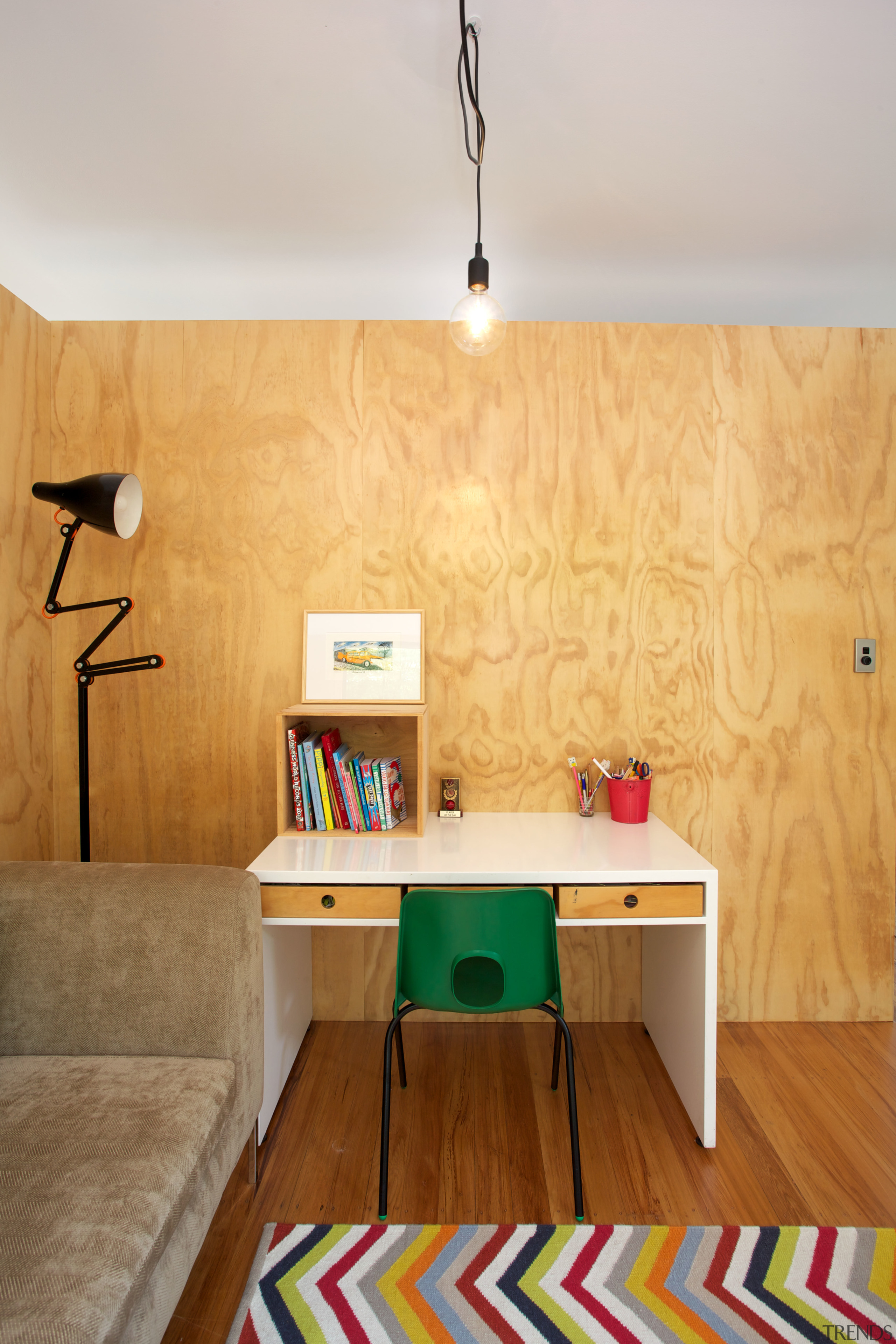 Pine plywood lines the interior of the black ceiling, desk, floor, flooring, furniture, hardwood, home, house, interior design, living room, plywood, product design, room, shelf, table, wall, wood, orange, gray, brown