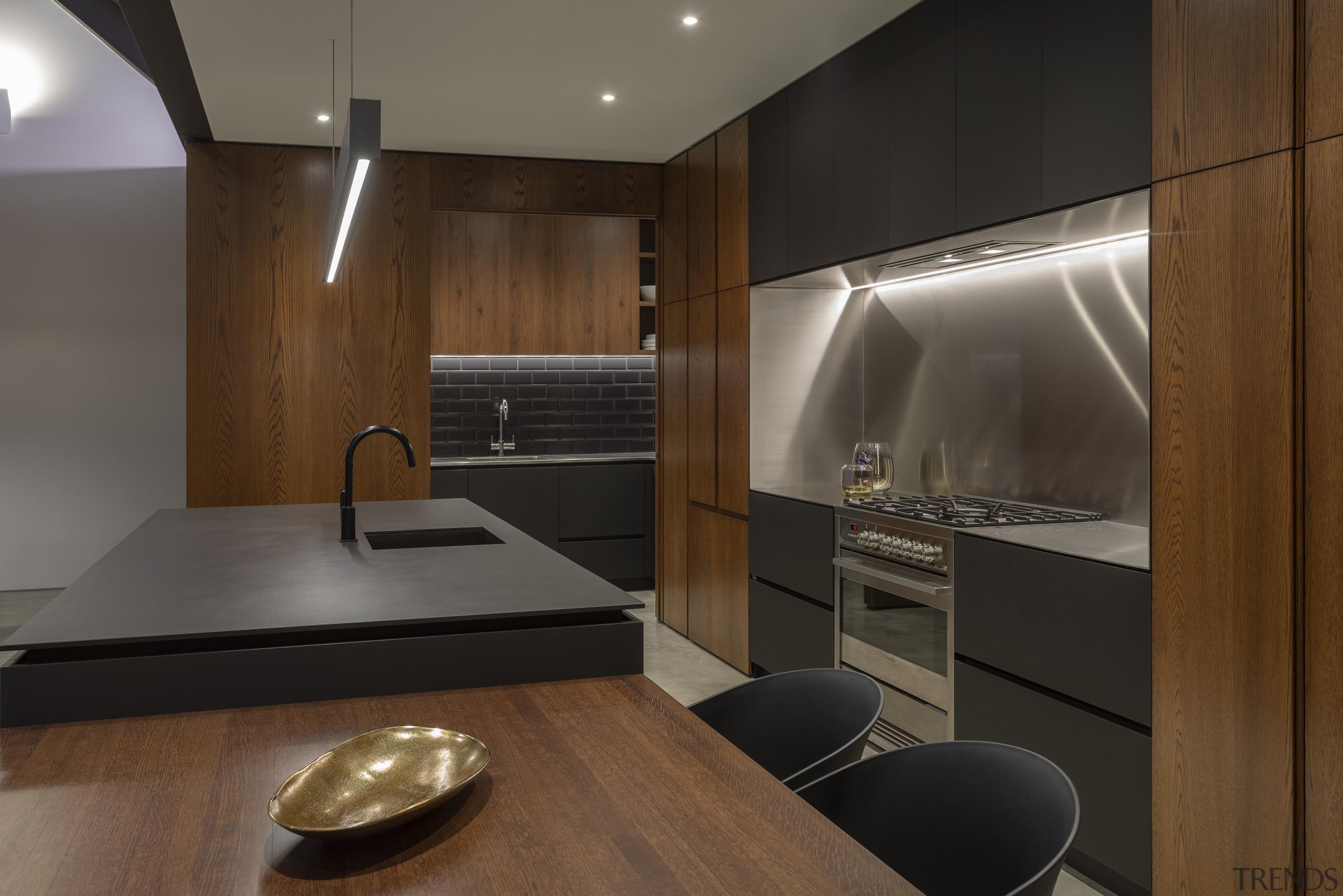 Creating a sense of symmetry was critical to architecture, cabinetry, countertop, splashback, backsplash, stainless steel, interior design, kitchen, Cube Dentro, Dekton domos