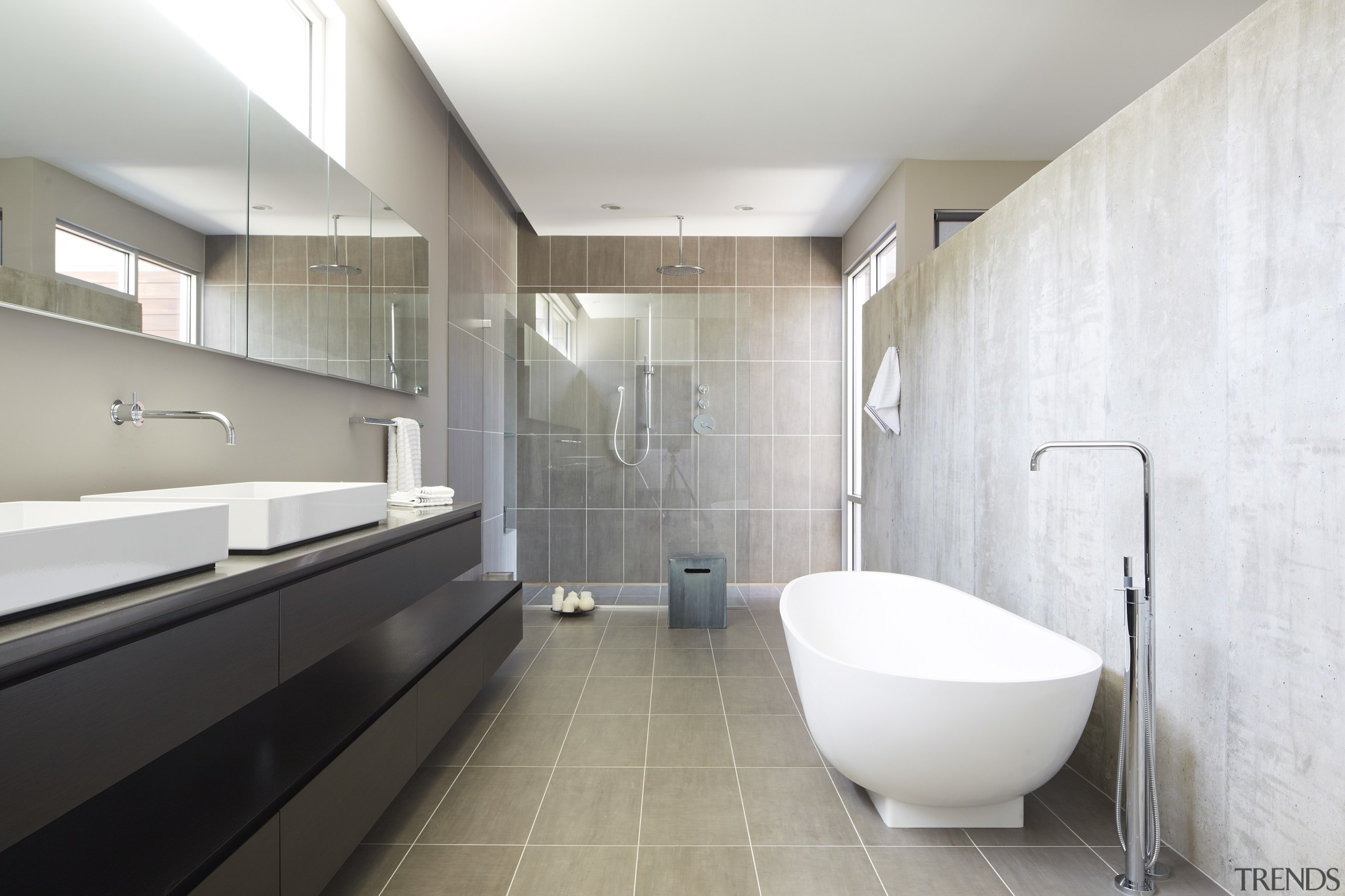 The handleless wenge vanity in this bathroom consists architecture, bathroom, floor, interior design, room, tile, gray, white