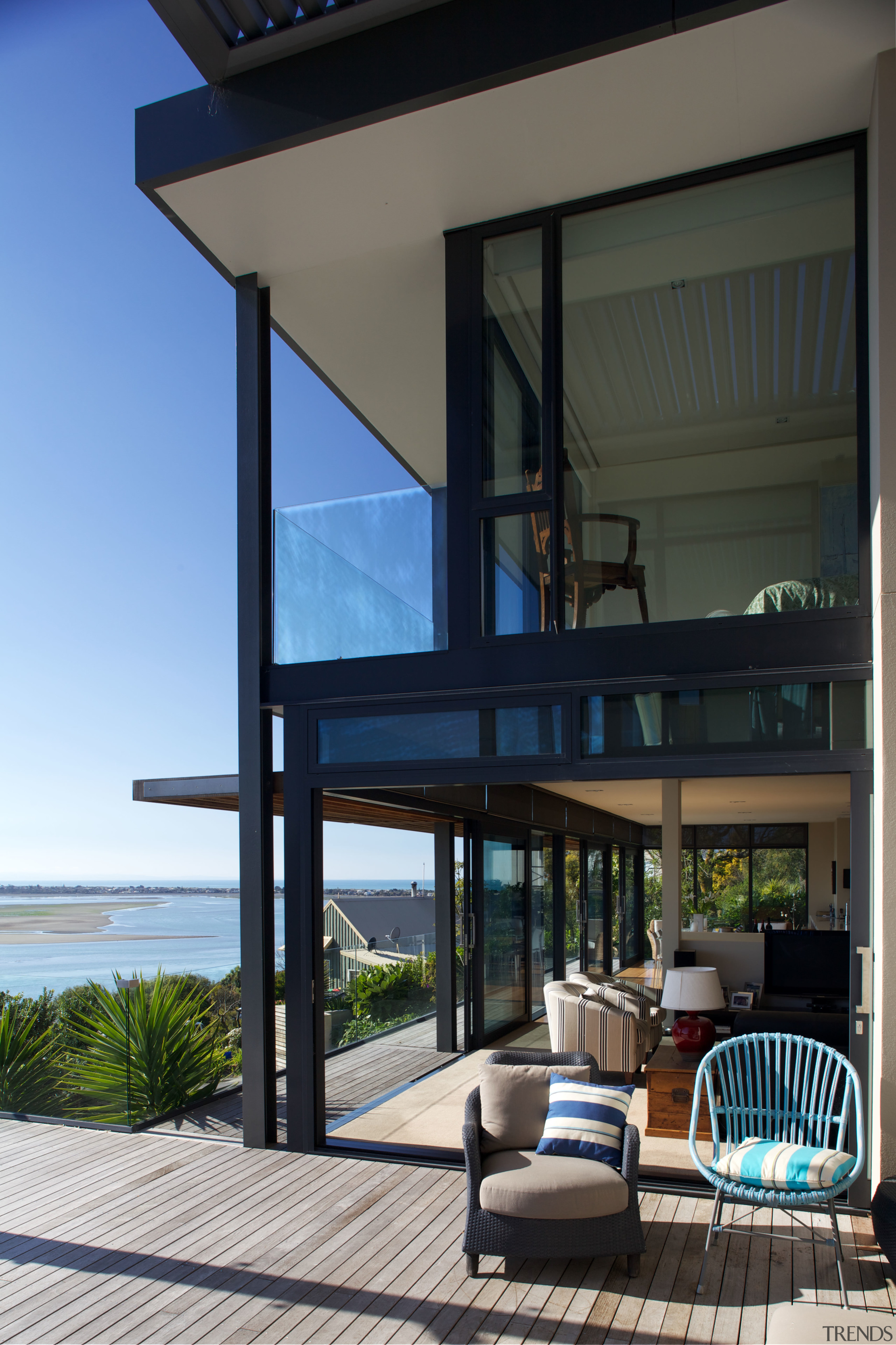 Sliding doors open living spaces to the outdoors. apartment, architecture, balcony, condominium, estate, home, house, interior design, property, real estate, window, black
