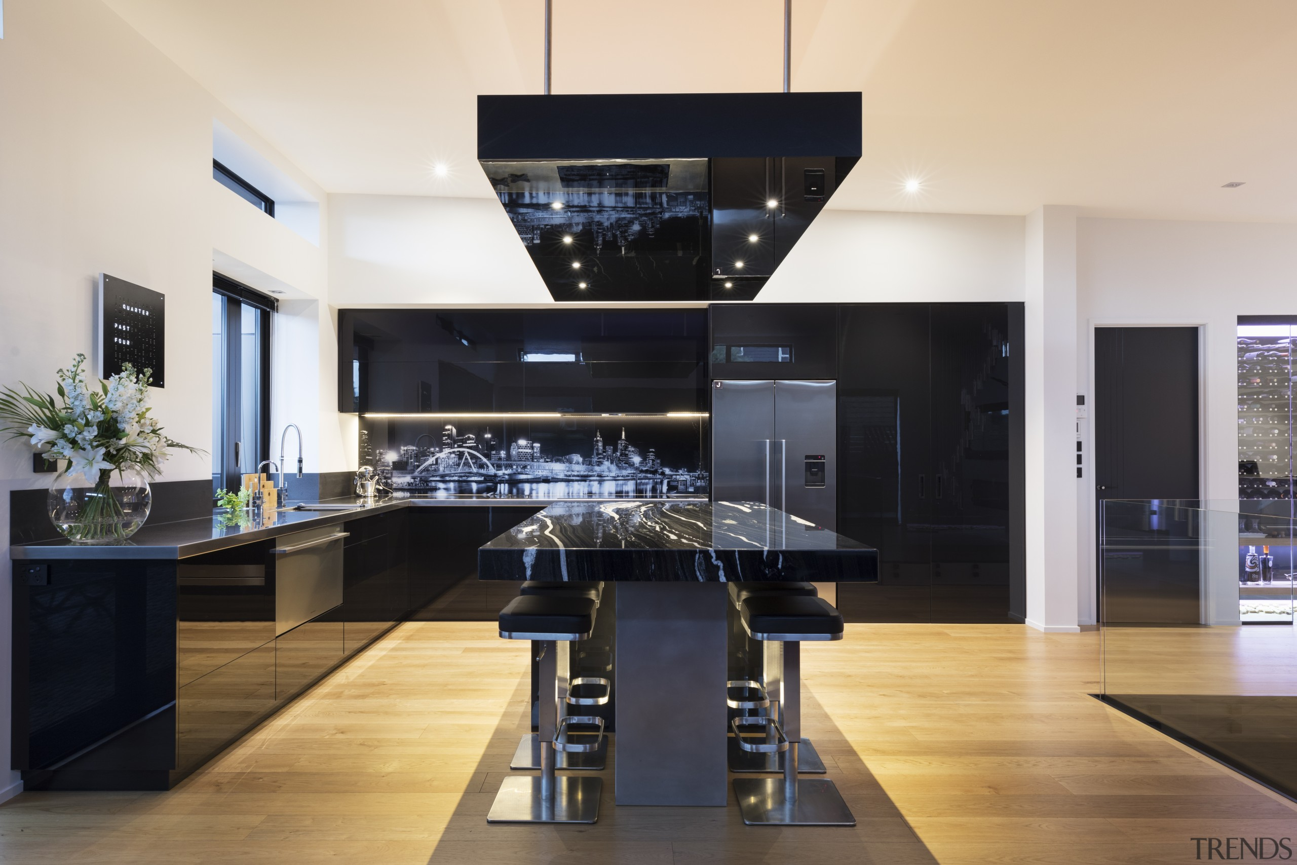 The kitchen is an L-shape, with a seating countertop, interior design, kitchen, black, white
