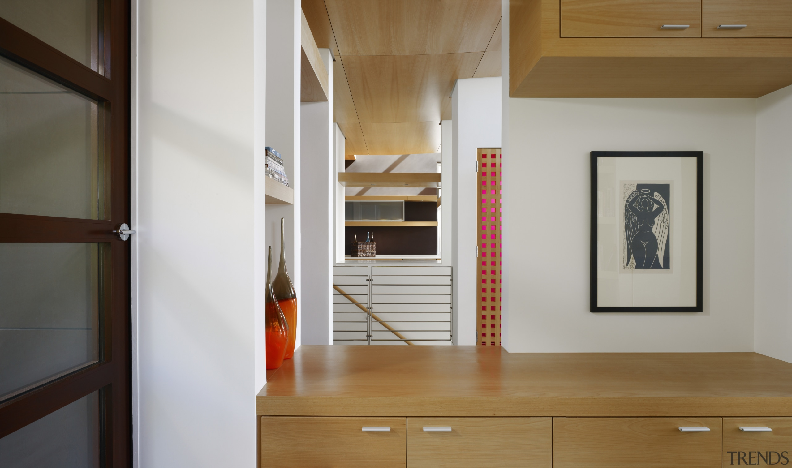 View of timber cabinetry with a stairway in cabinetry, floor, flooring, furniture, hardwood, interior design, room, wood, gray, brown