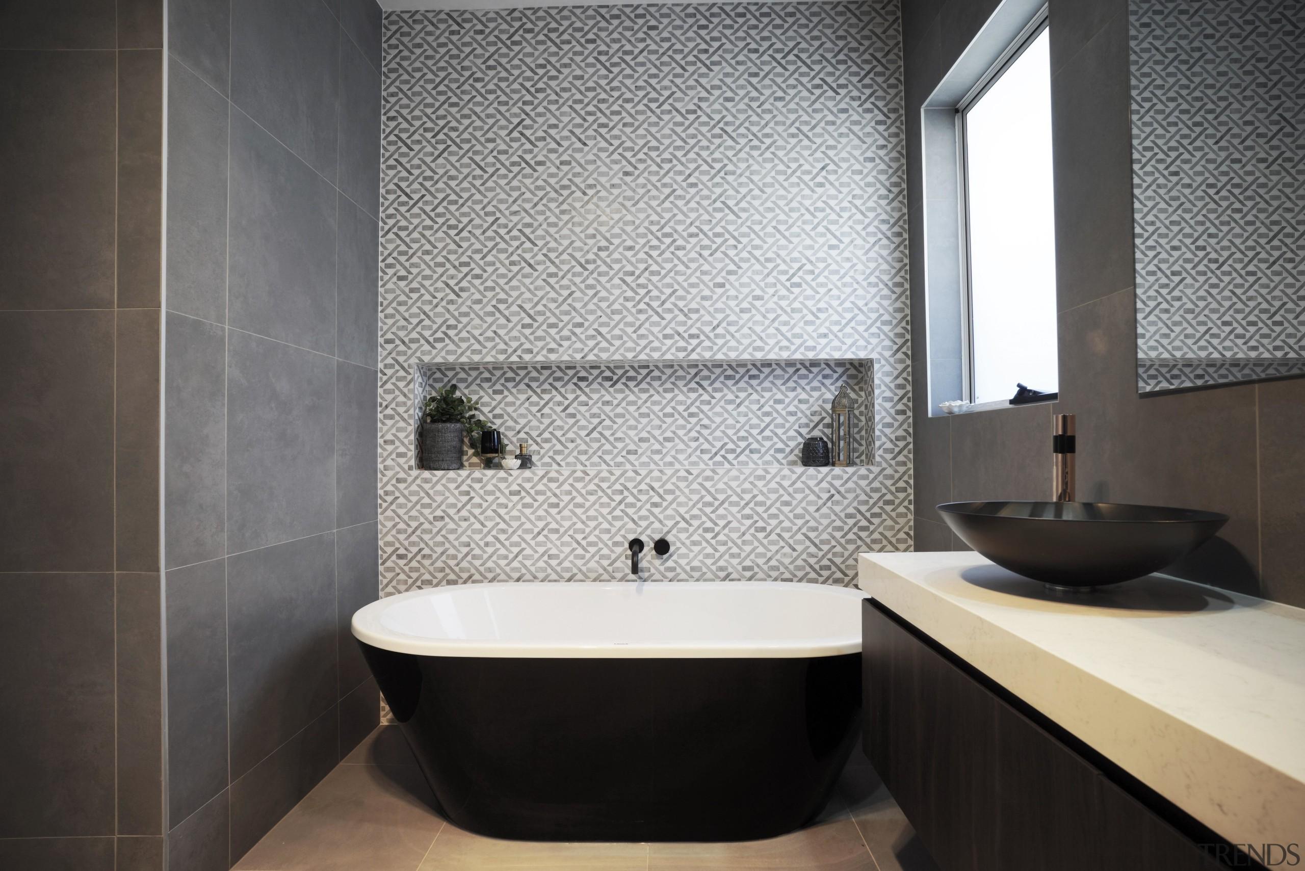 Your motivation for renovating will impact the decisions architecture, bathroom, bathroom accessory, bathtub, bidet, ceramic, floor, flooring, interior design, plumbing fixture, property, room, sink, tap, tile, toilet, wall, black, gray