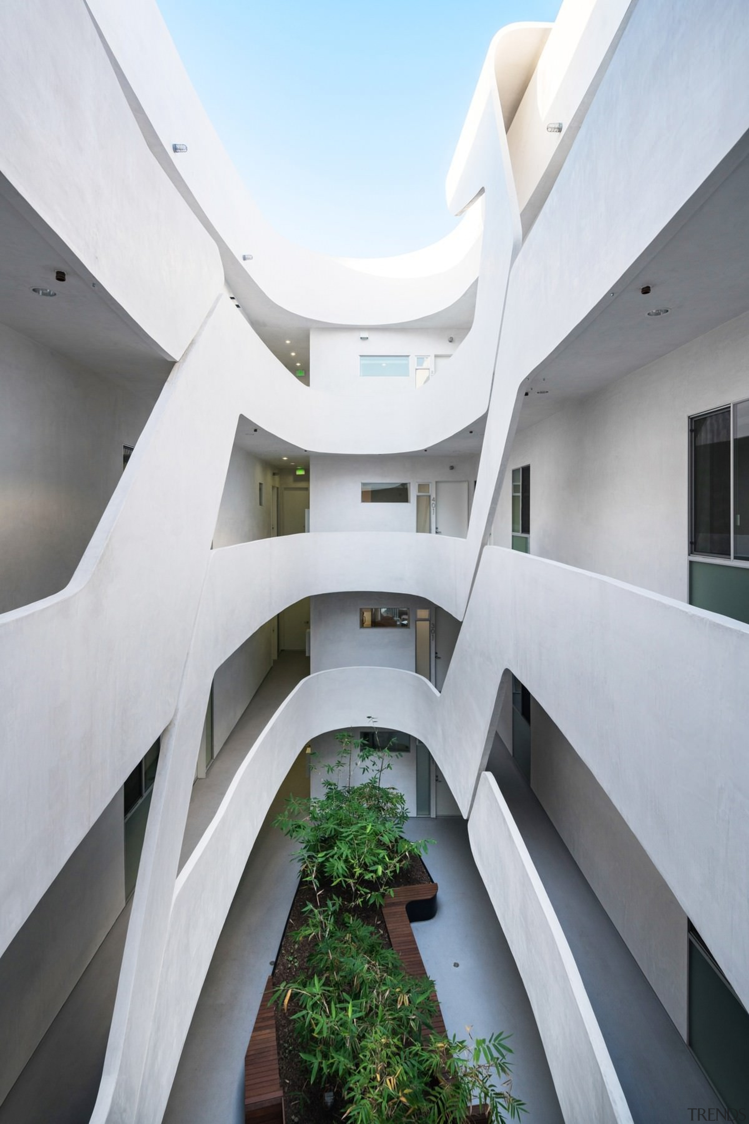 This courtyard area is a like a set apartment, architecture, building, condominium, daylighting, facade, headquarters, house, real estate, stairs, white