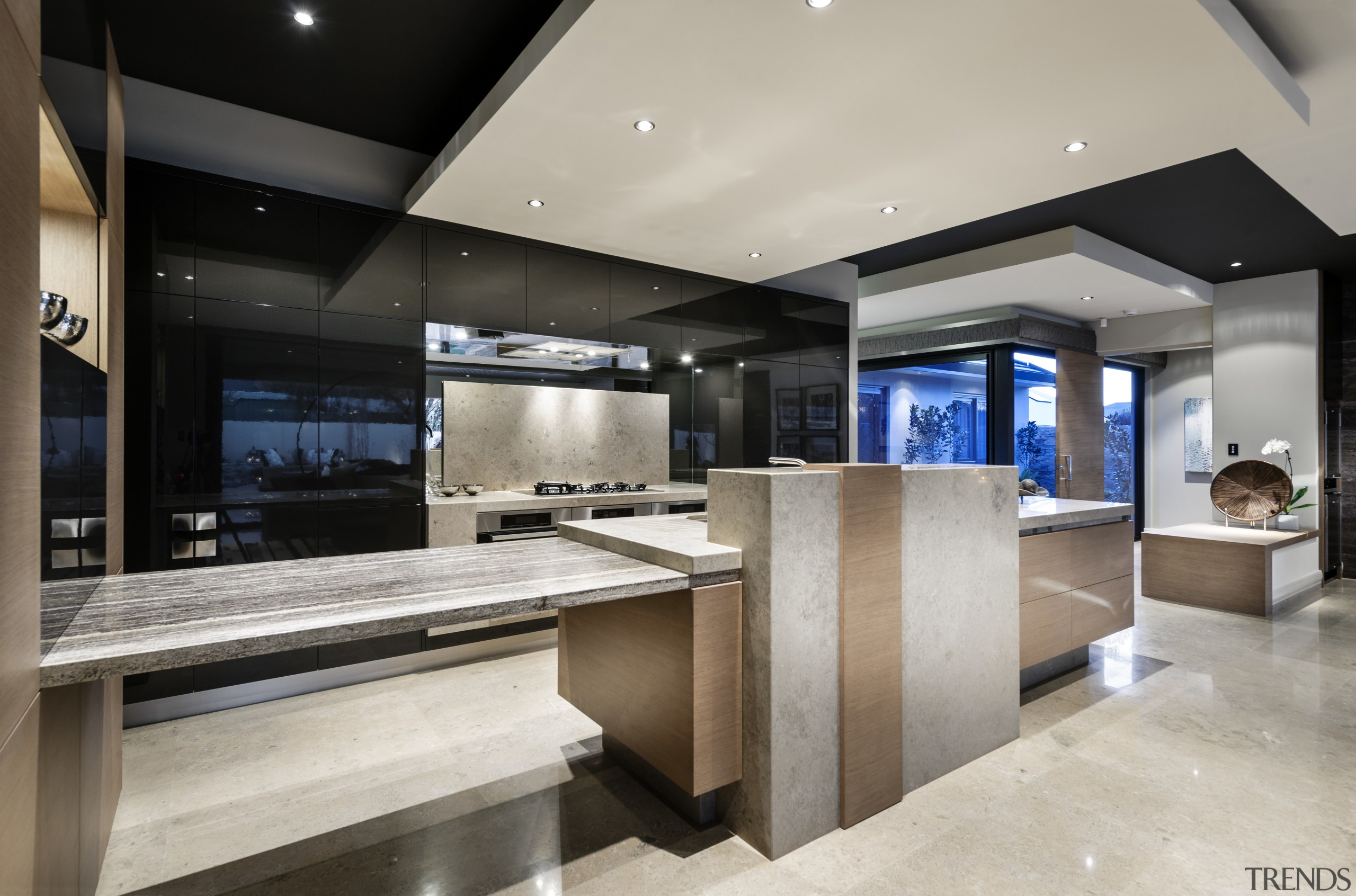 ELiving areas and kitchen are seamlessly integrated in countertop, interior design, kitchen, gray, black