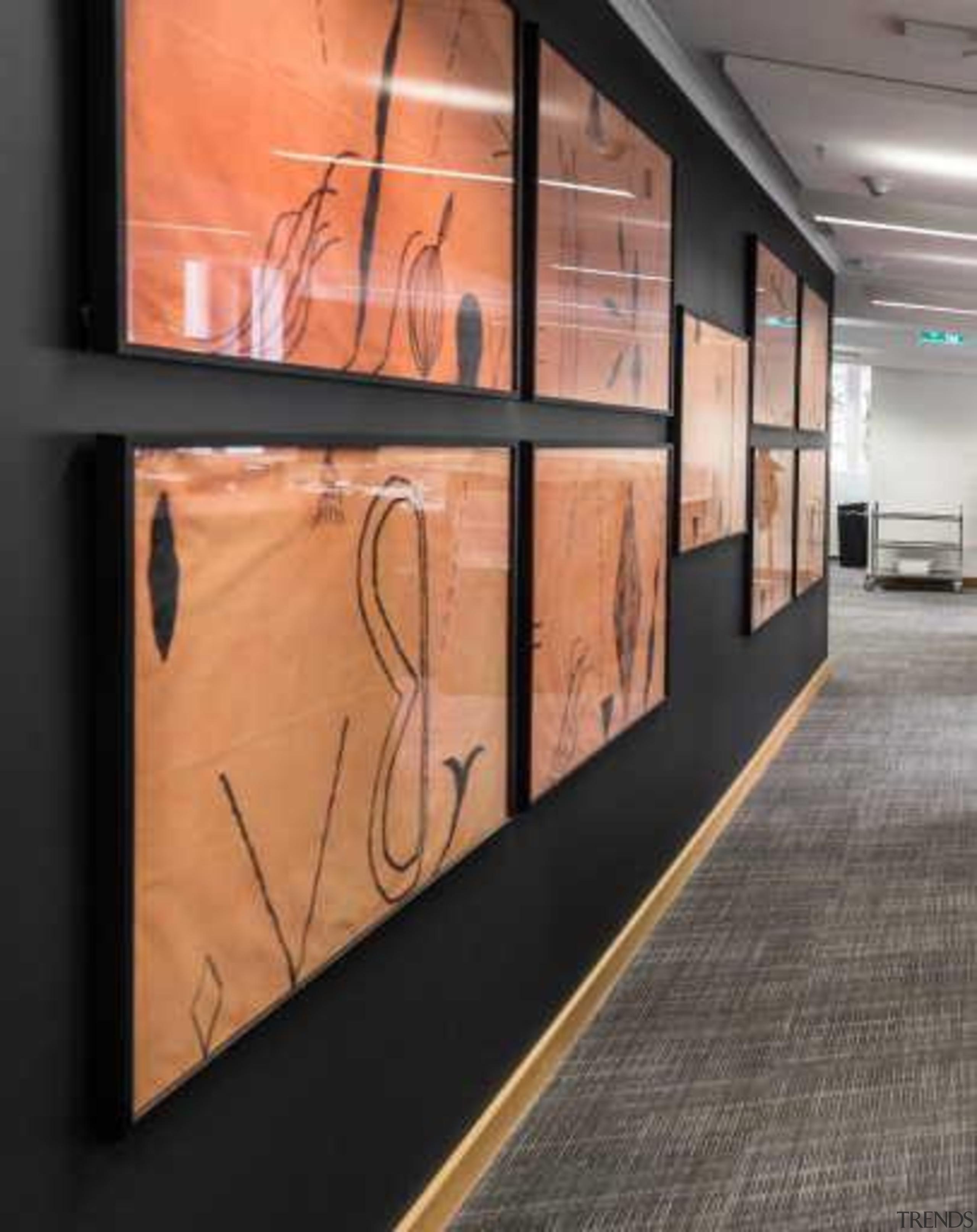 "New acoustic walls were also built,"" says Sami. exhibition, floor, flooring, wall, black, orange, gray"