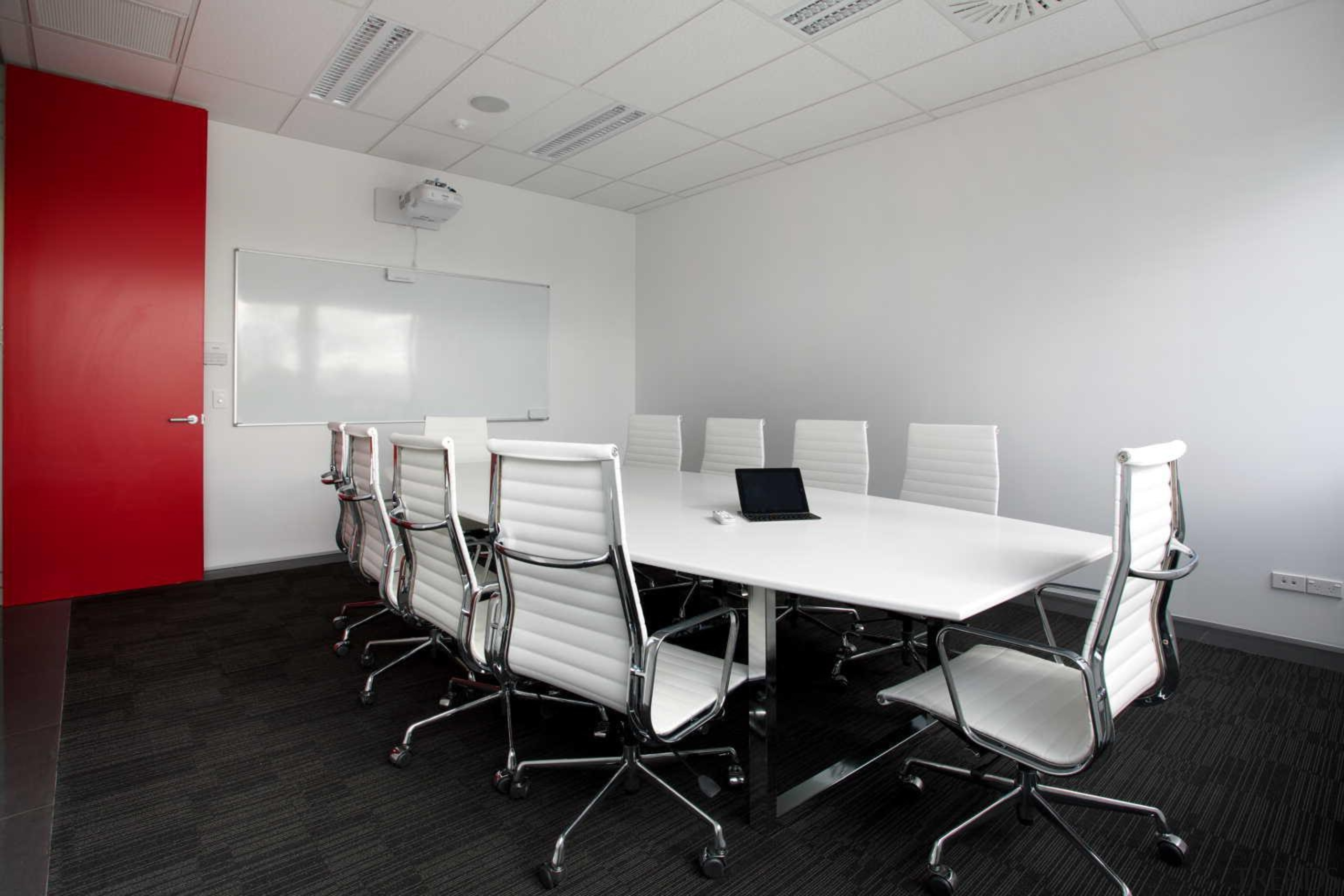 Interiors @ OfficeMax supplied a bespoke one-piece boardroom chair, conference hall, floor, furniture, interior design, office, product design, table, gray, black