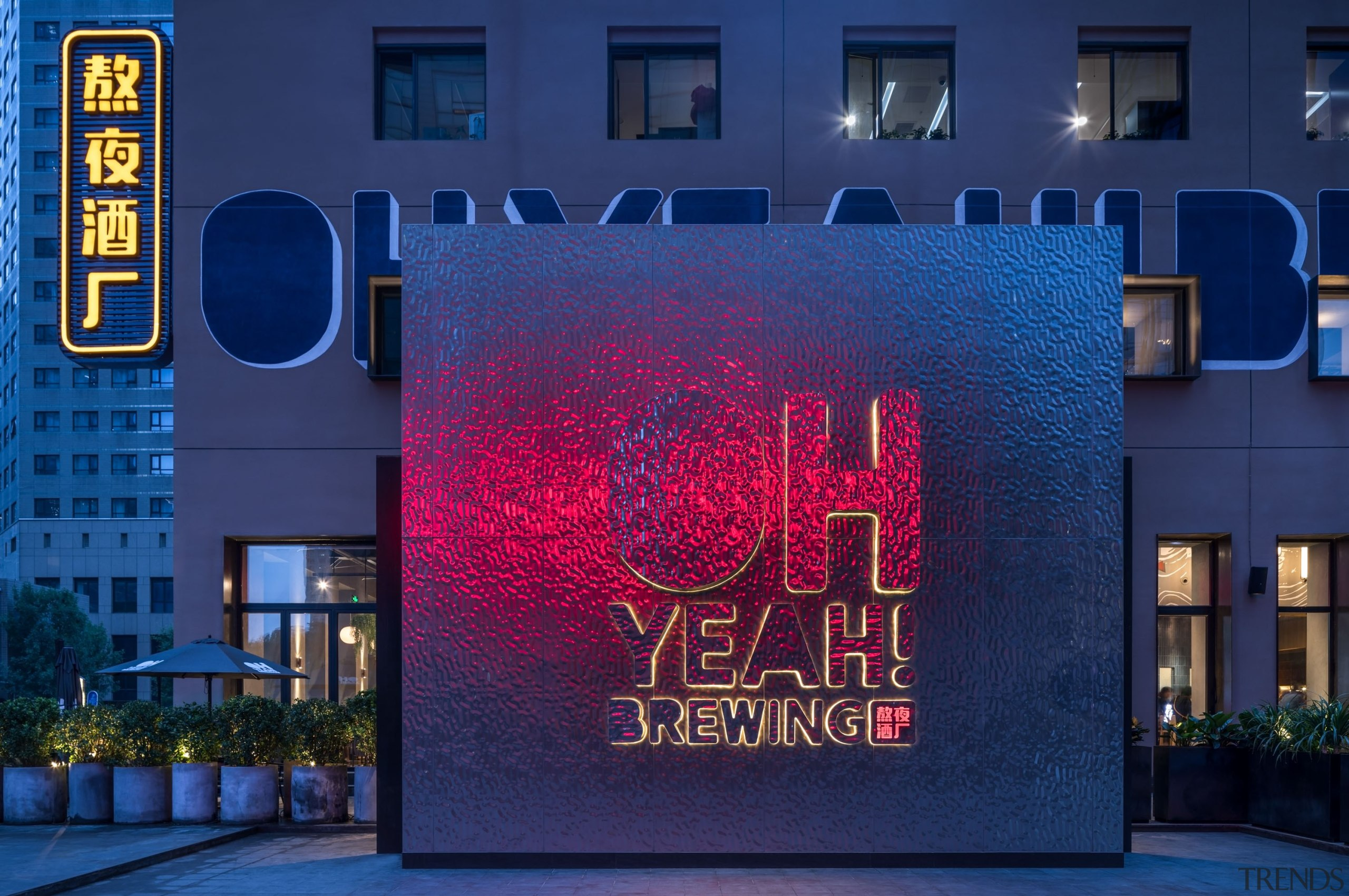 """On the exterior, the large fontlettering of """"Oh advertising, architecture, blue, building, electronic signage, facade, font, light, lighting, neon, night, real estate, signage, technology, blue"""