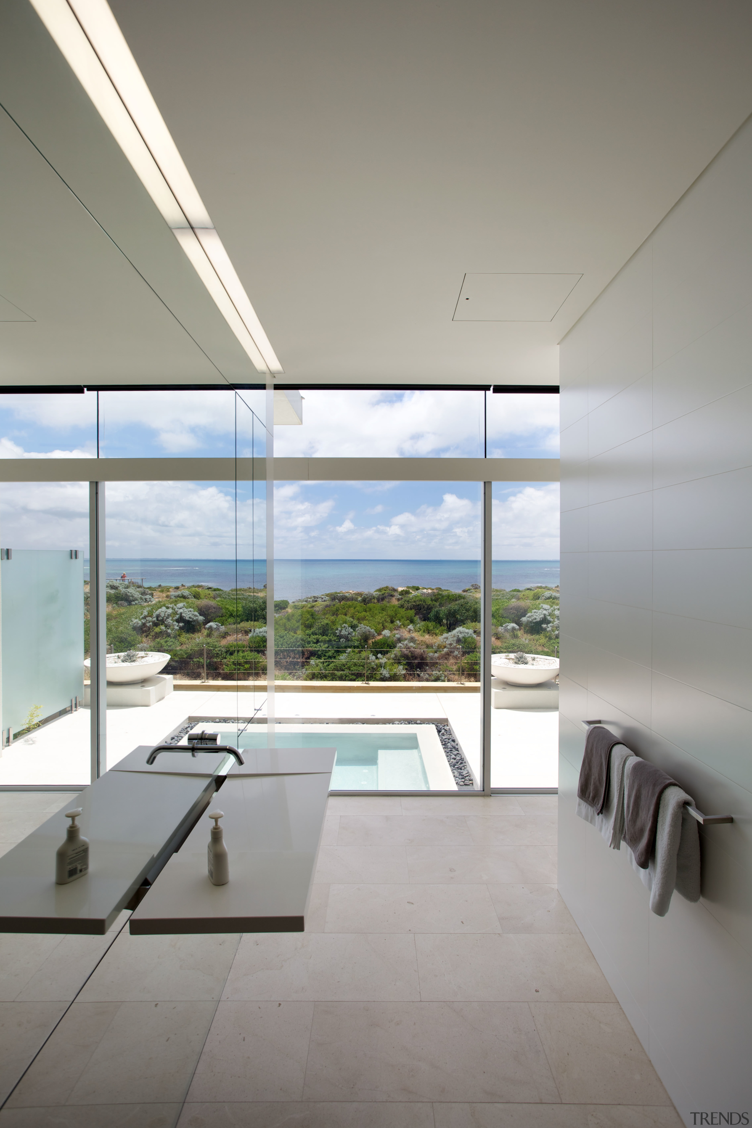 This guest bathroom overlooks the pool, sand dunes architecture, ceiling, condominium, daylighting, daytime, glass, house, interior design, product design, real estate, window, gray