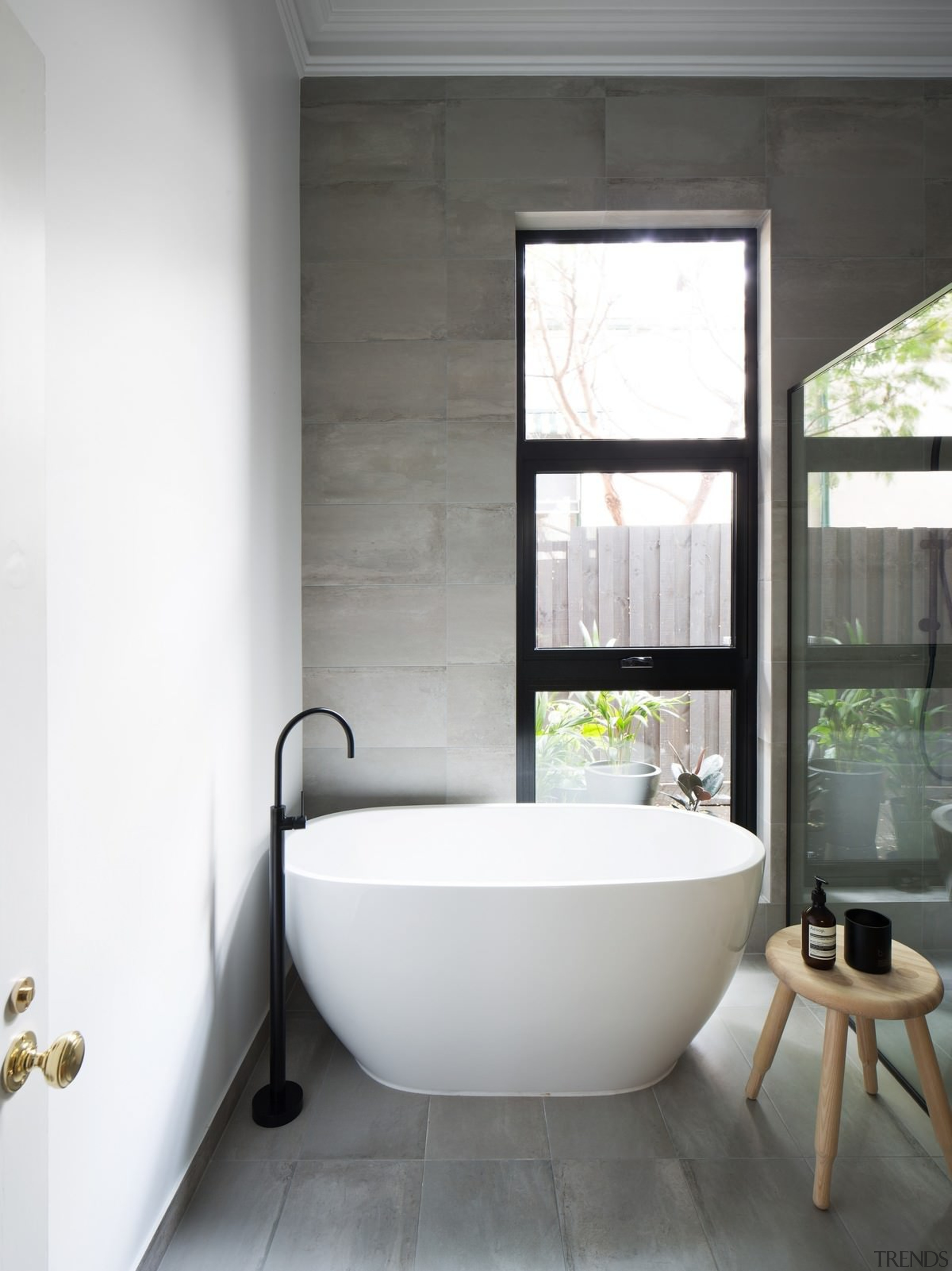 The designer used the same tiles on the architecture, bathroom, floor, home, house, interior design, plumbing fixture, product design, room, tap, window, white, gray