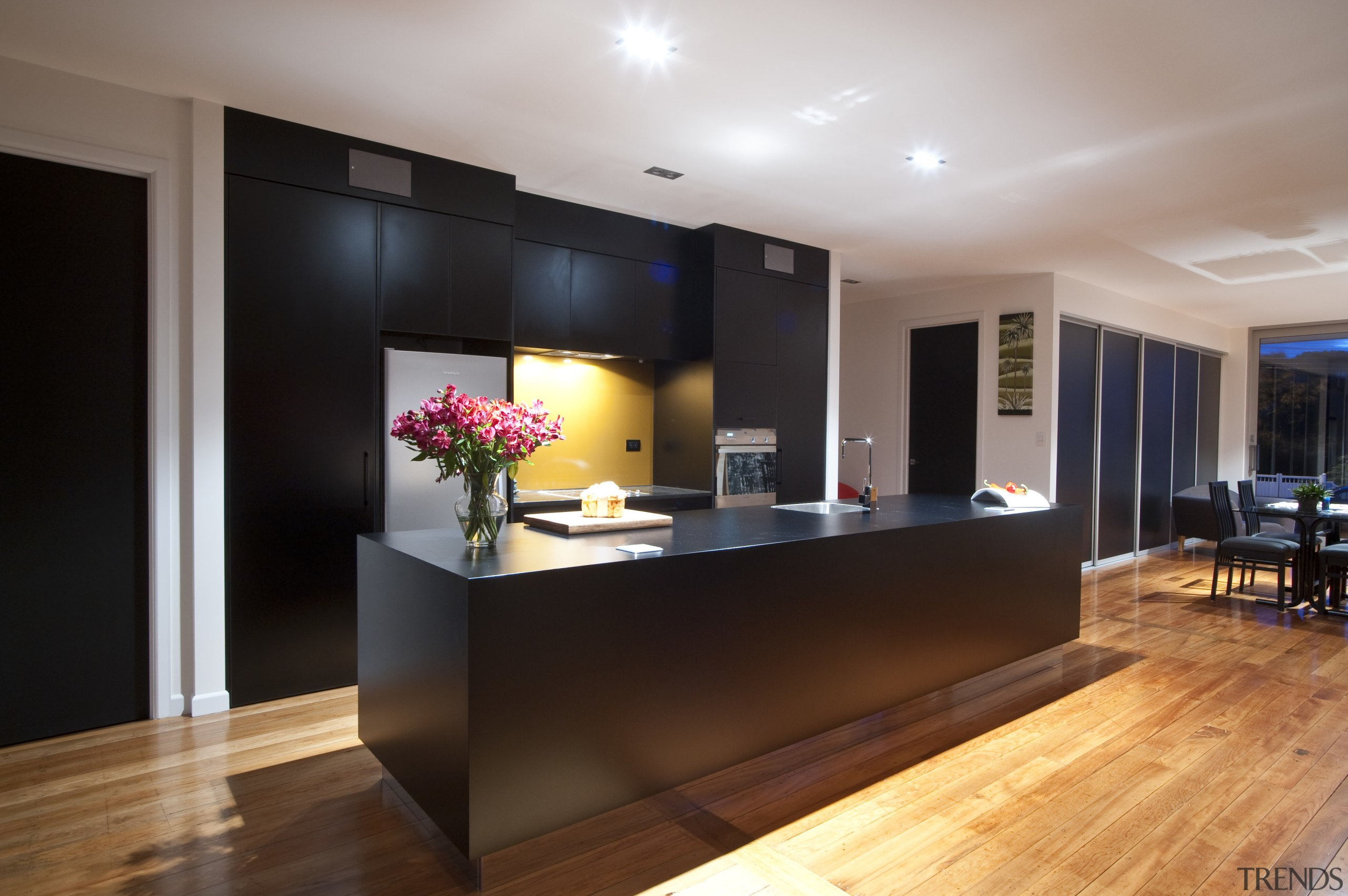 This new kitchen designed by Nicola Mason of cabinetry, ceiling, countertop, floor, flooring, hardwood, interior design, kitchen, real estate, room, wood flooring, black, gray
