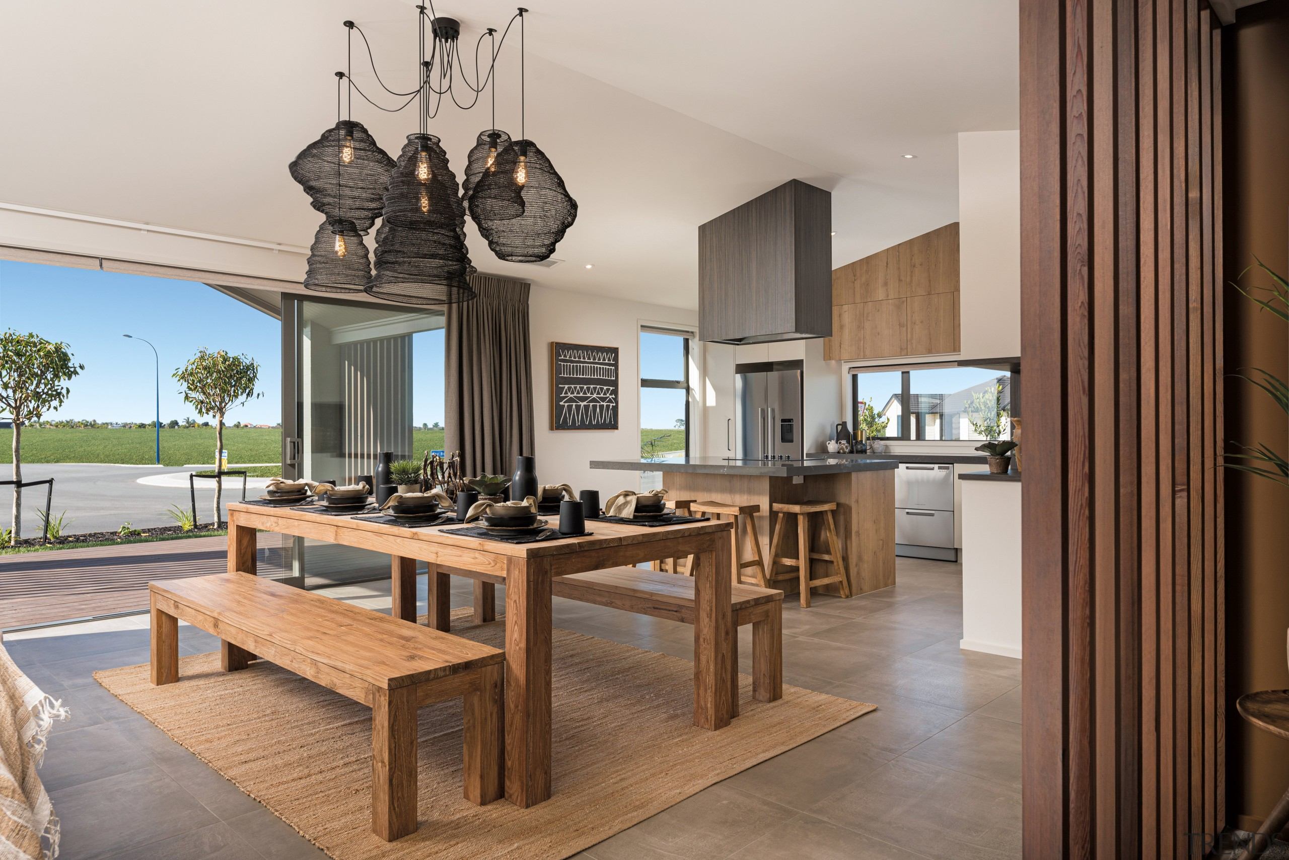 This generous family-dining-kitchen area in a GJ Gardner gray, brown