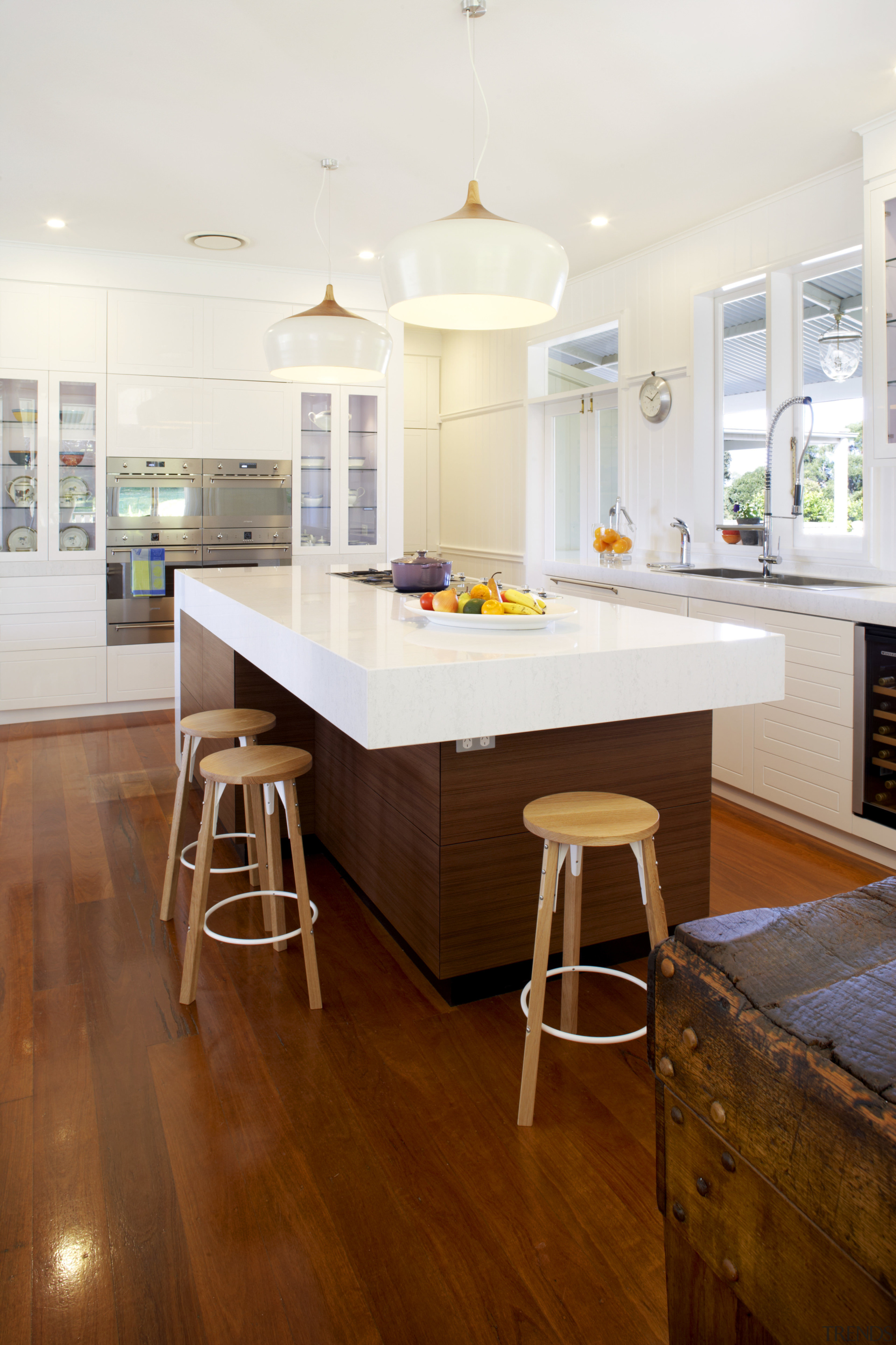 Clean, crisp cabinets are juxtaposed against a well-worn cabinetry, ceiling, countertop, cuisine classique, floor, flooring, hardwood, home, interior design, kitchen, laminate flooring, real estate, room, table, wood, wood flooring, white, brown