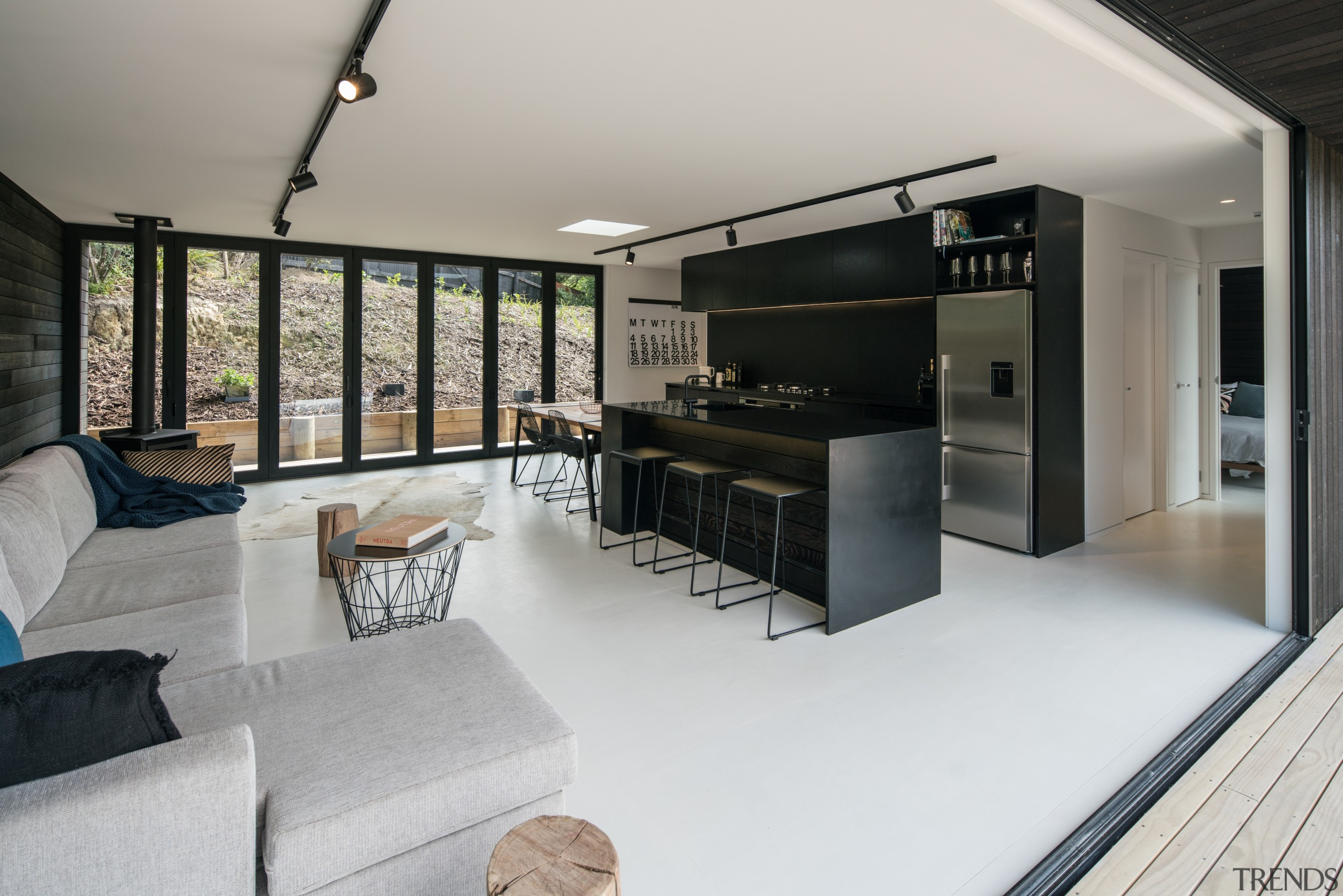 This kitchen looks modest in size but is architecture, house, interior design, living room, real estate, gray