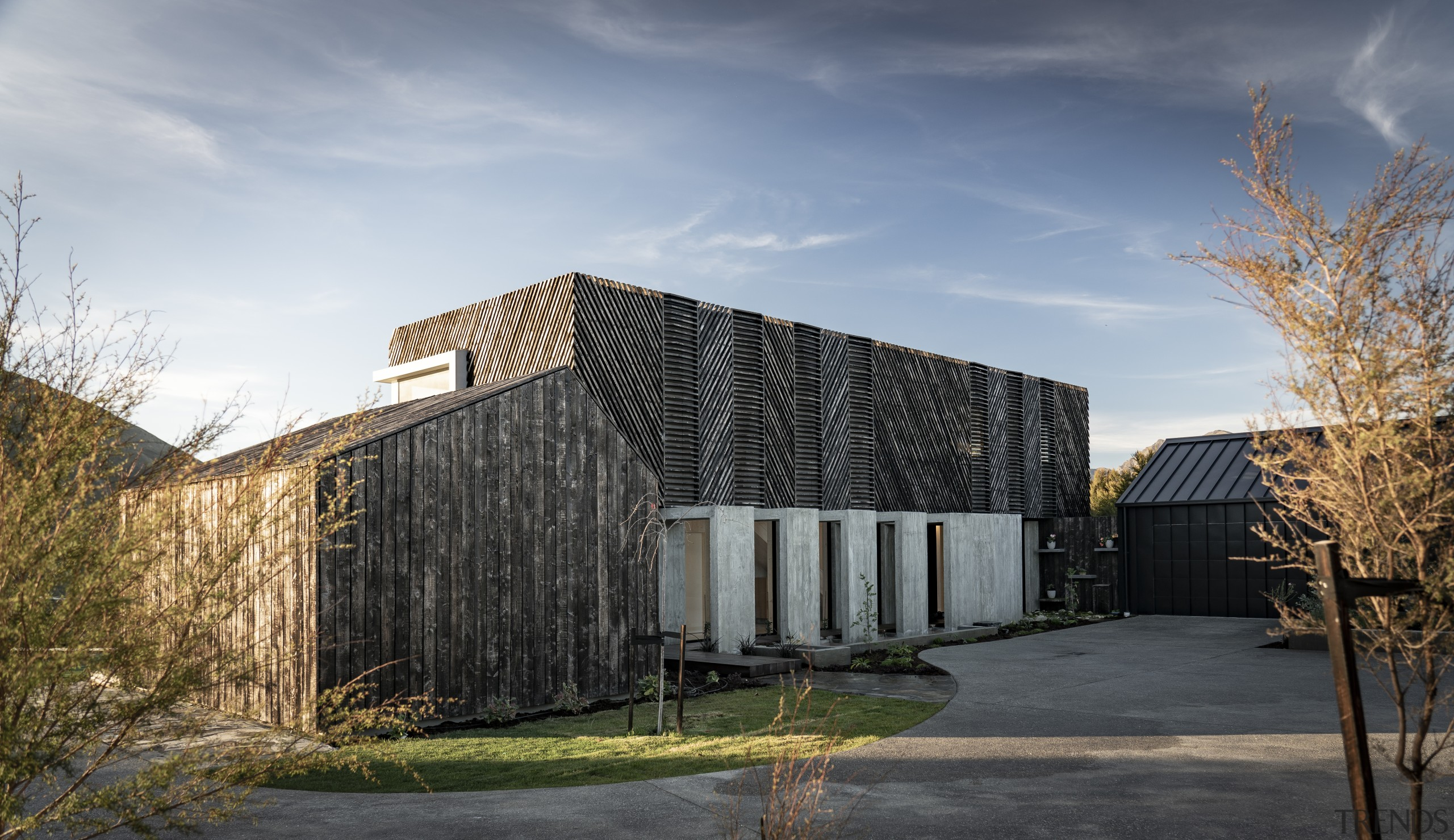The wooden elements of this home's facade will gray