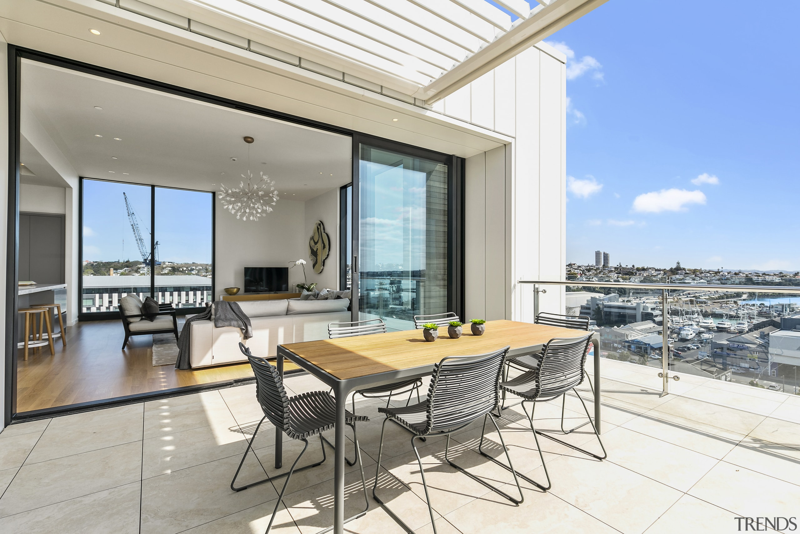 These pages:The Apartments residences at Wynyard Central include apartment, architecture, building, daylighting, estate, floor, furniture, home, house, interior design, living room, penthouse apartment, property, real estate, roof, room, table, window, white