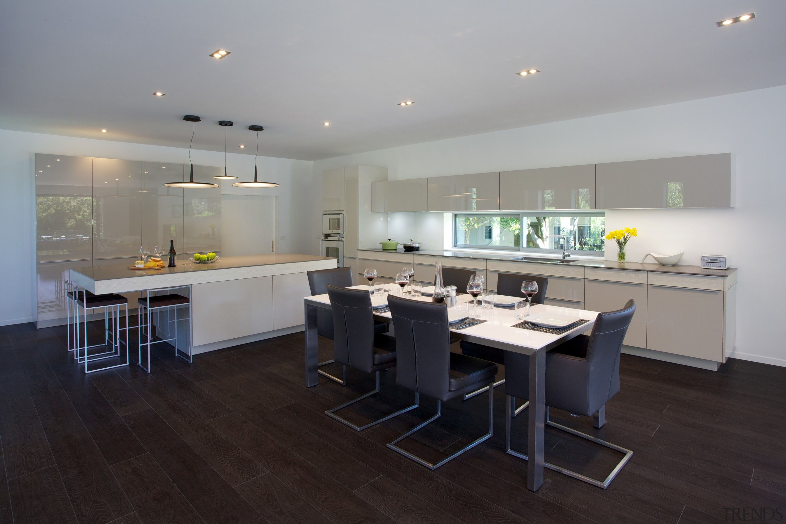 The sliding door in the end wall of countertop, interior design, kitchen, property, room, gray, black