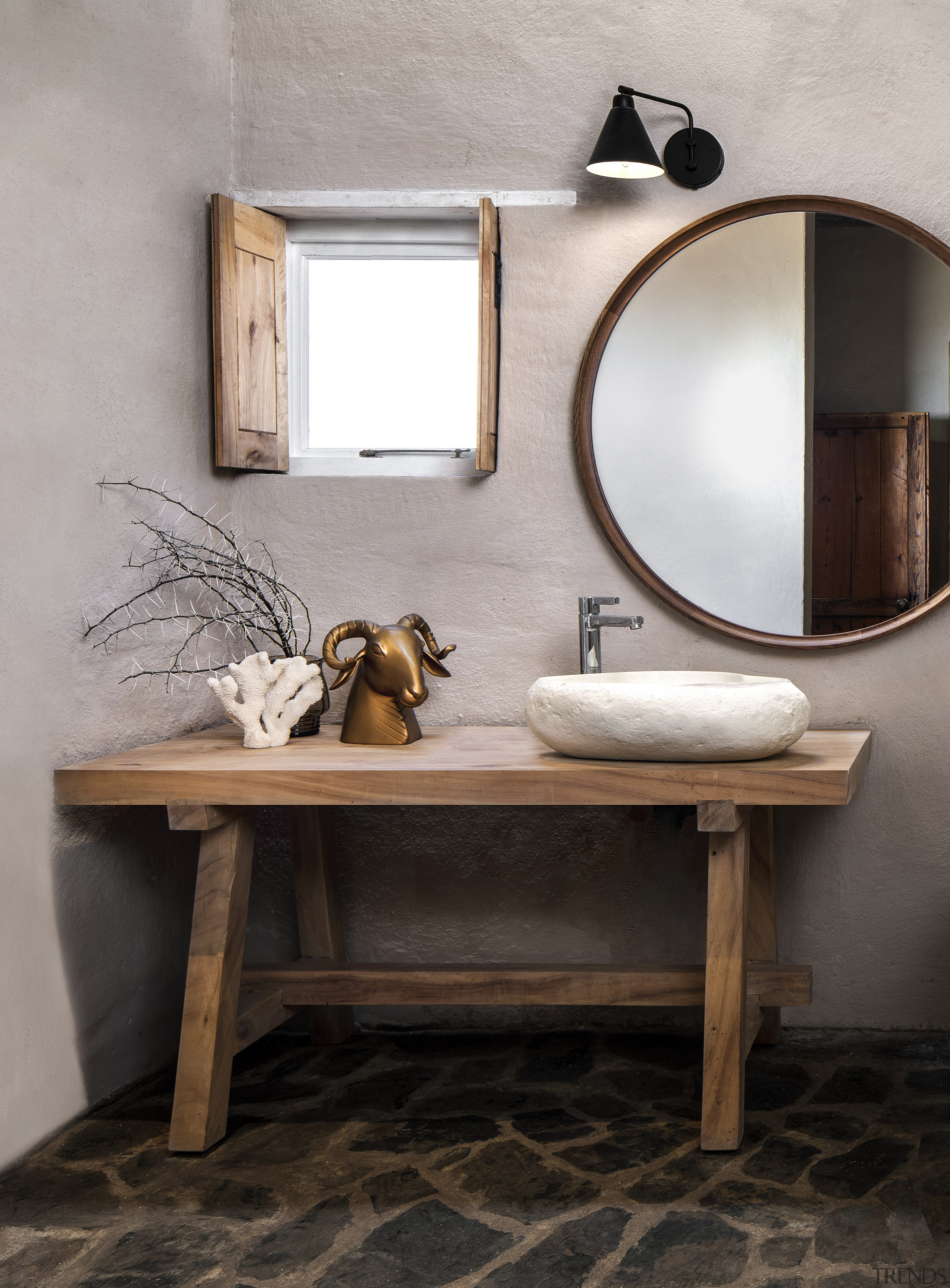 A custom-made poplar vanity and shutters were added