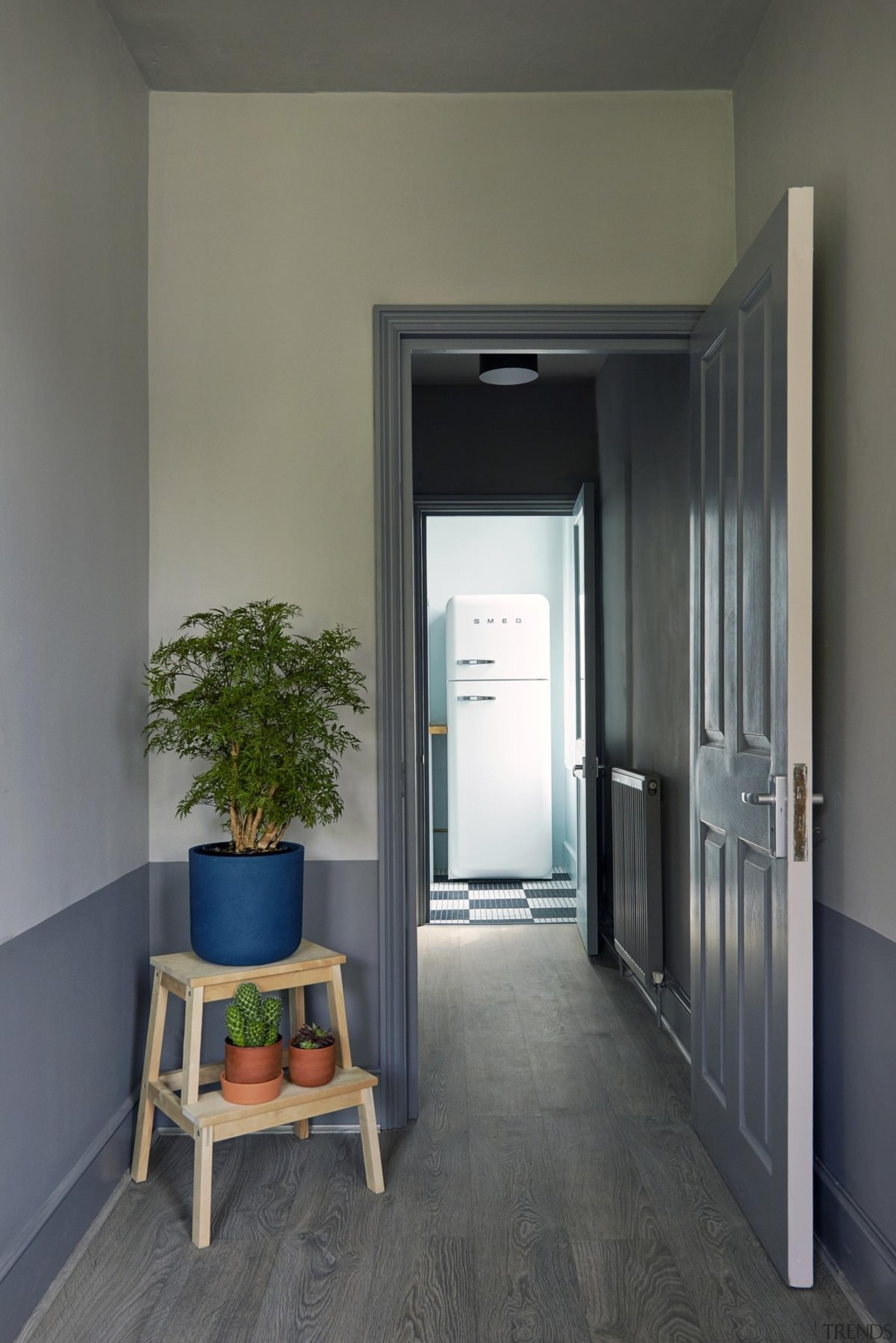 Wood floors run down the hallway to an door, floor, home, interior design, window, gray, black