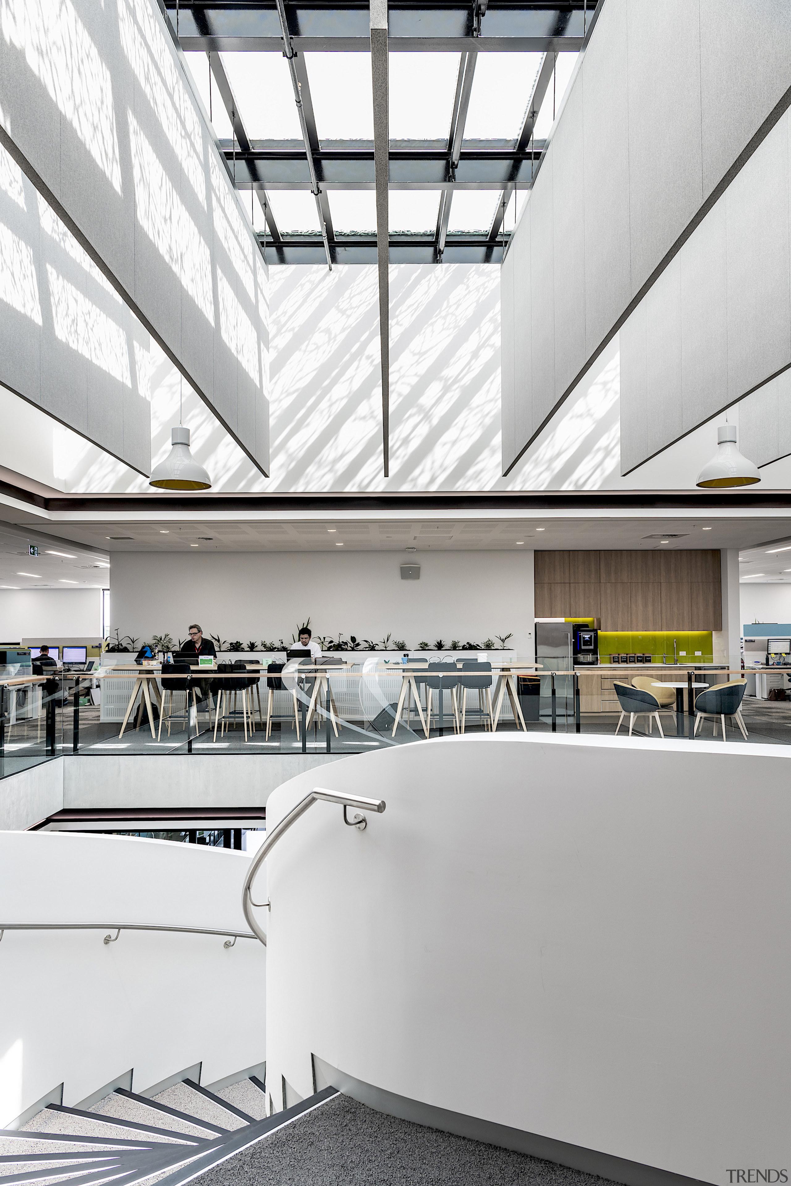 Giant panels hang midair in the atrium, providing
