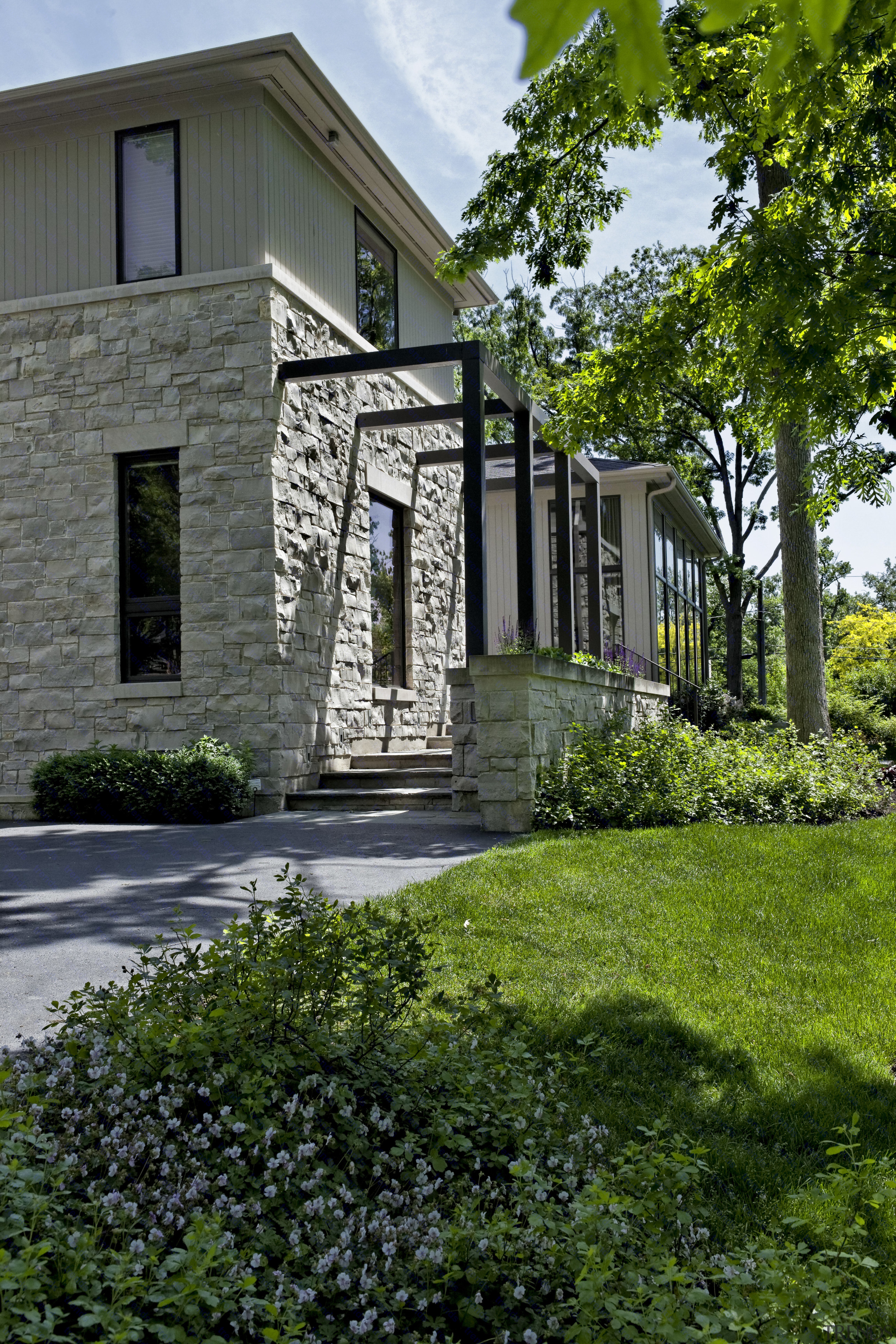 stone outside with paving and lawn architecture, building, cottage, estate, facade, farmhouse, home, house, landscaping, neighbourhood, outdoor structure, property, real estate, residential area, siding, walkway, window, yard, green