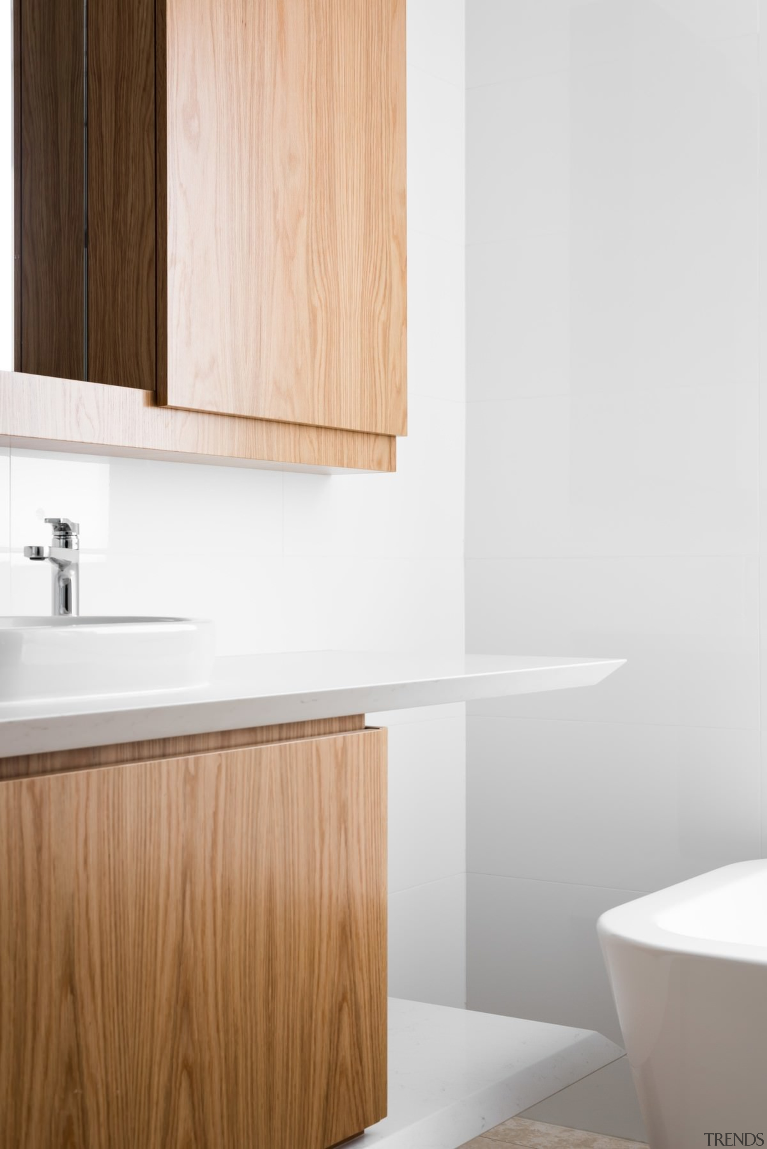 Wood cabinets in the bathroom are a nice bathroom, bathroom accessory, bathroom cabinet, bathroom sink, floor, hardwood, interior design, plumbing fixture, plywood, product, product design, sink, tap, tile, wall, wood, white