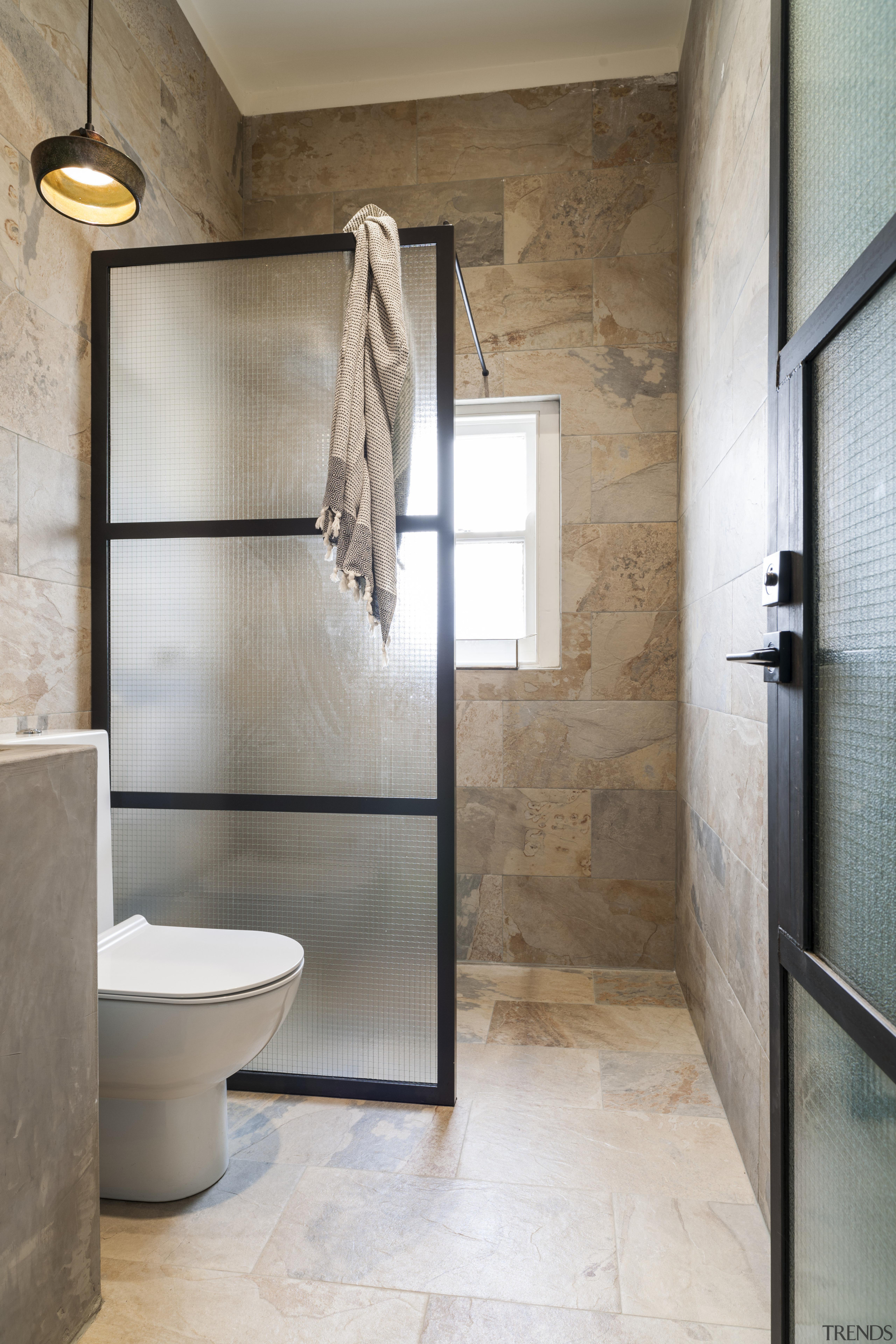 The powder room in this remodelled house features architecture, bathroom, floor, home, interior design, plumbing fixture, room, tile, gray