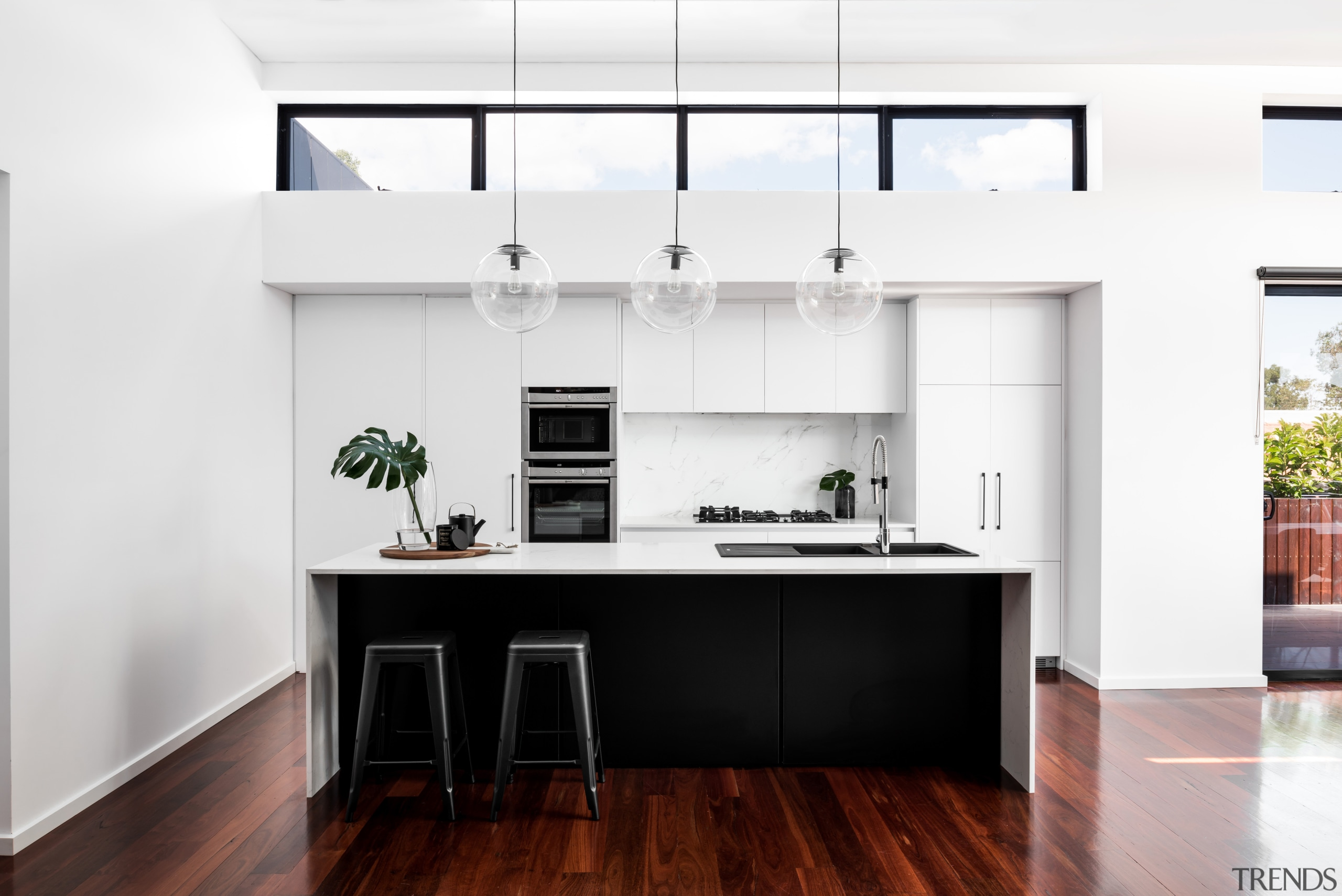 A picture in black and white, this modern countertop, house, interior design, kitchen, real estate, white
