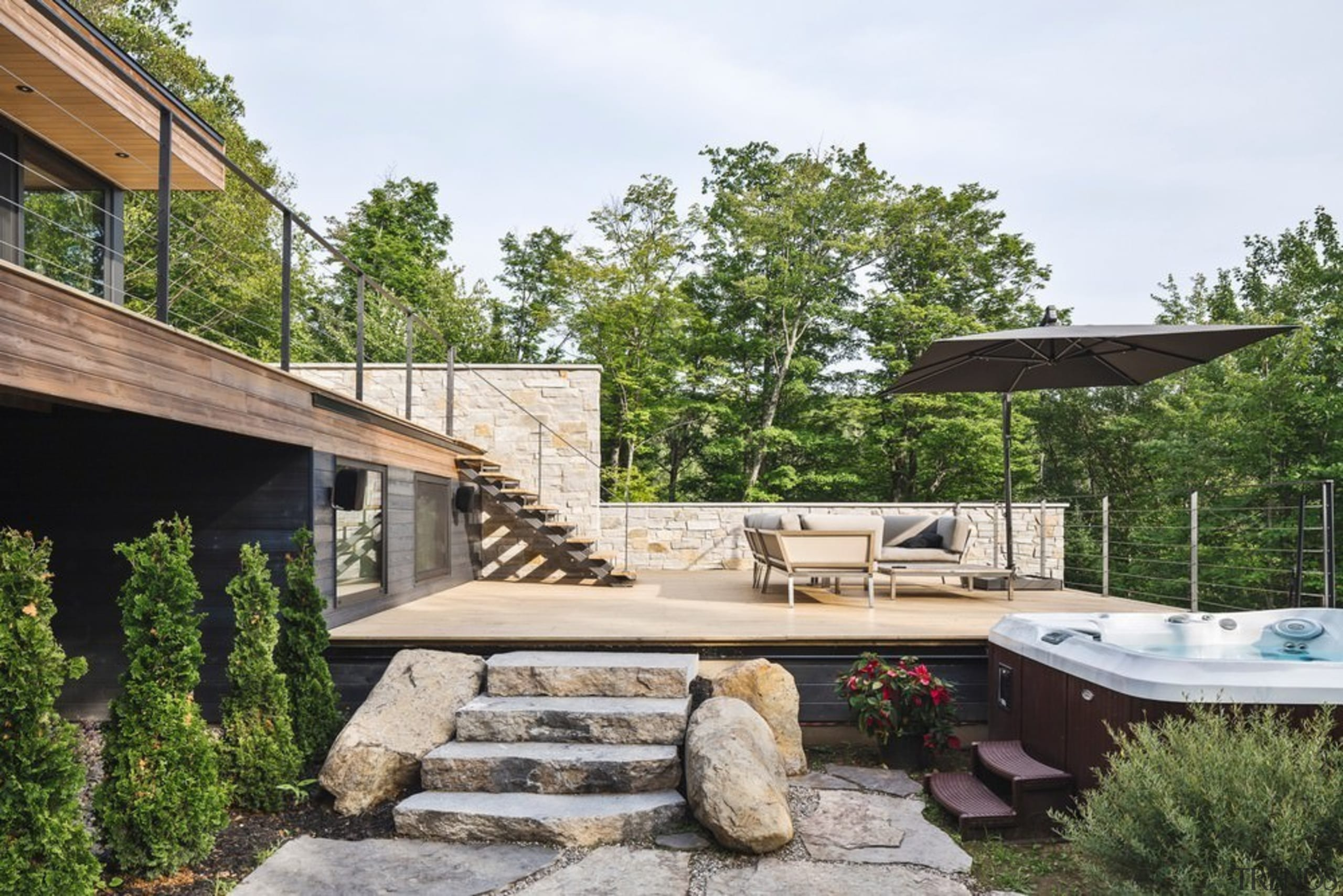 The house has an organic feel - The backyard, cottage, house, outdoor structure, property, real estate, wood, yard, brown, white