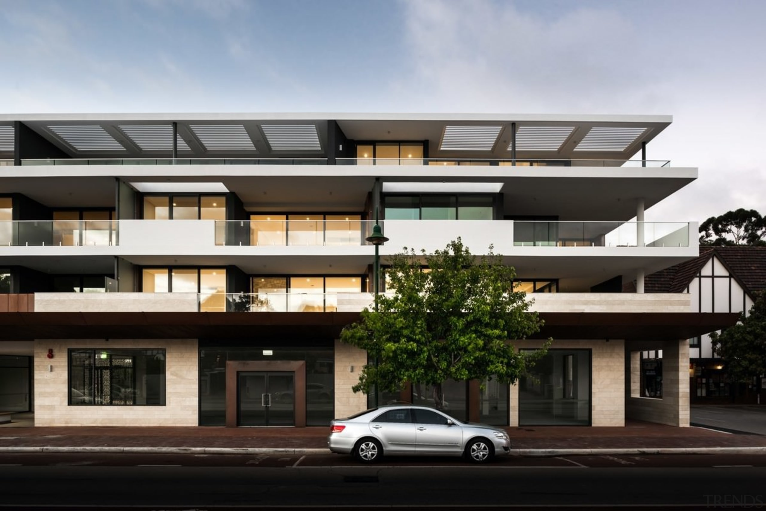 Screens on the top level diffuse the sunlight apartment, architecture, building, commercial building, condominium, elevation, facade, family car, house, luxury vehicle, mixed use, neighbourhood, property, real estate, residential area, black, gray