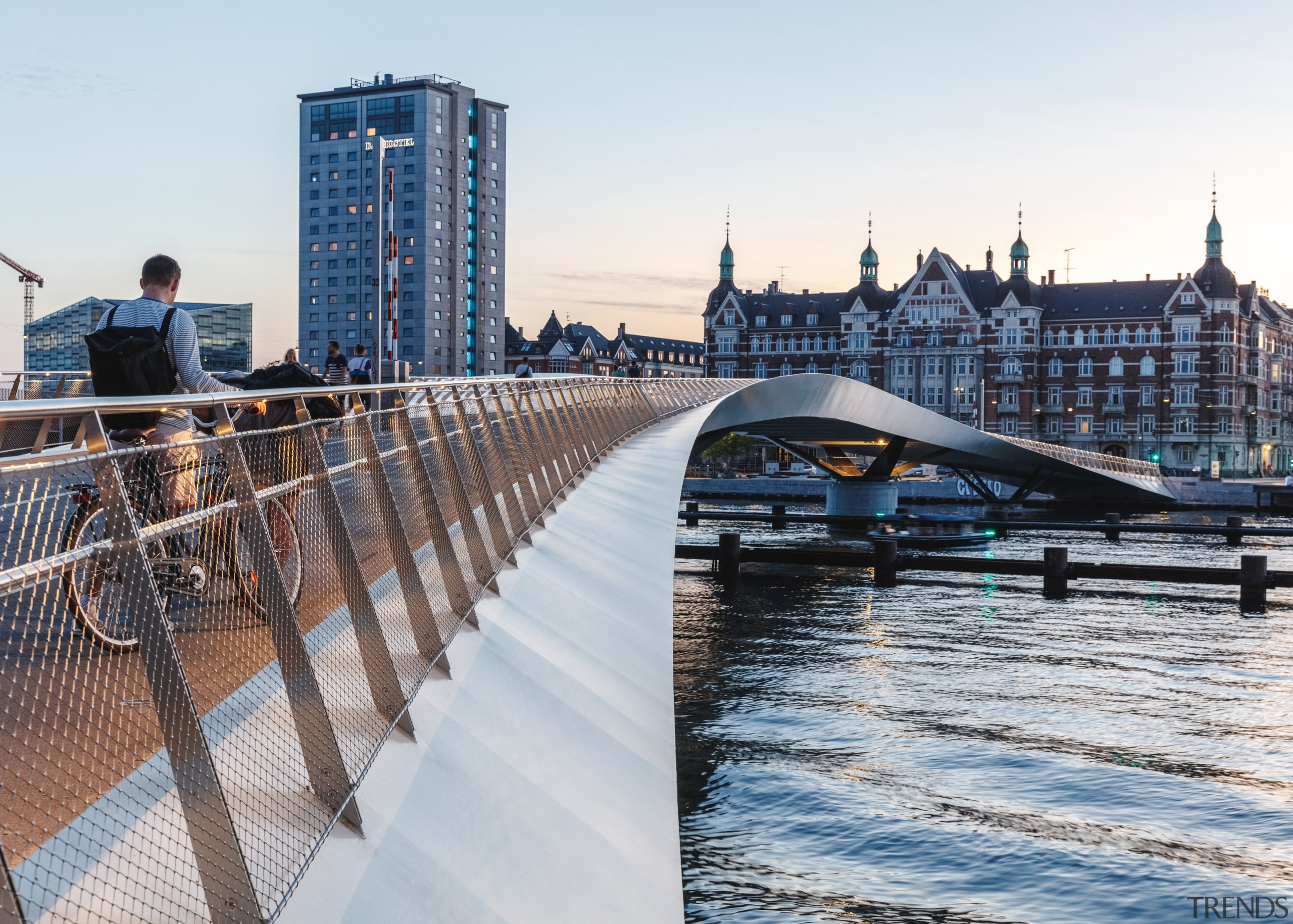 The flowing bridge connects with but also contrasts white