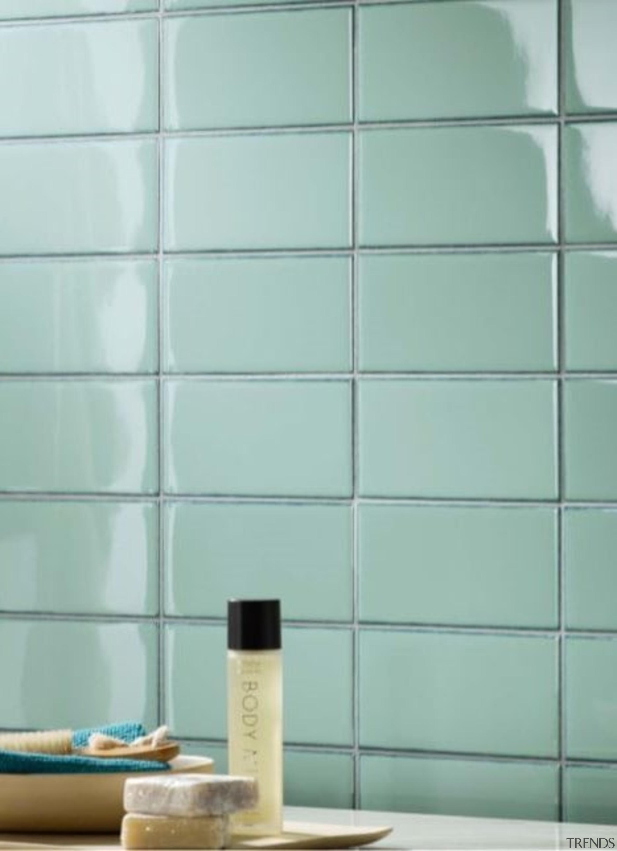 The high gloss finish reflects light, illuminating small floor, flooring, glass, interior design, product, shelf, tile, wall, gray