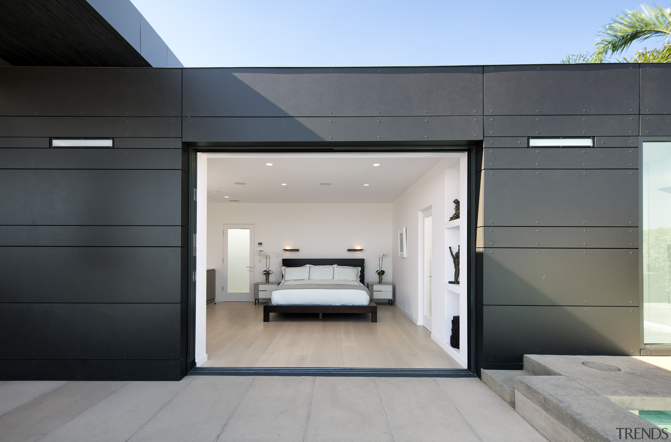 As throughout the rest of the home, this architecture, door, facade, home, house, interior design, real estate, gray, black
