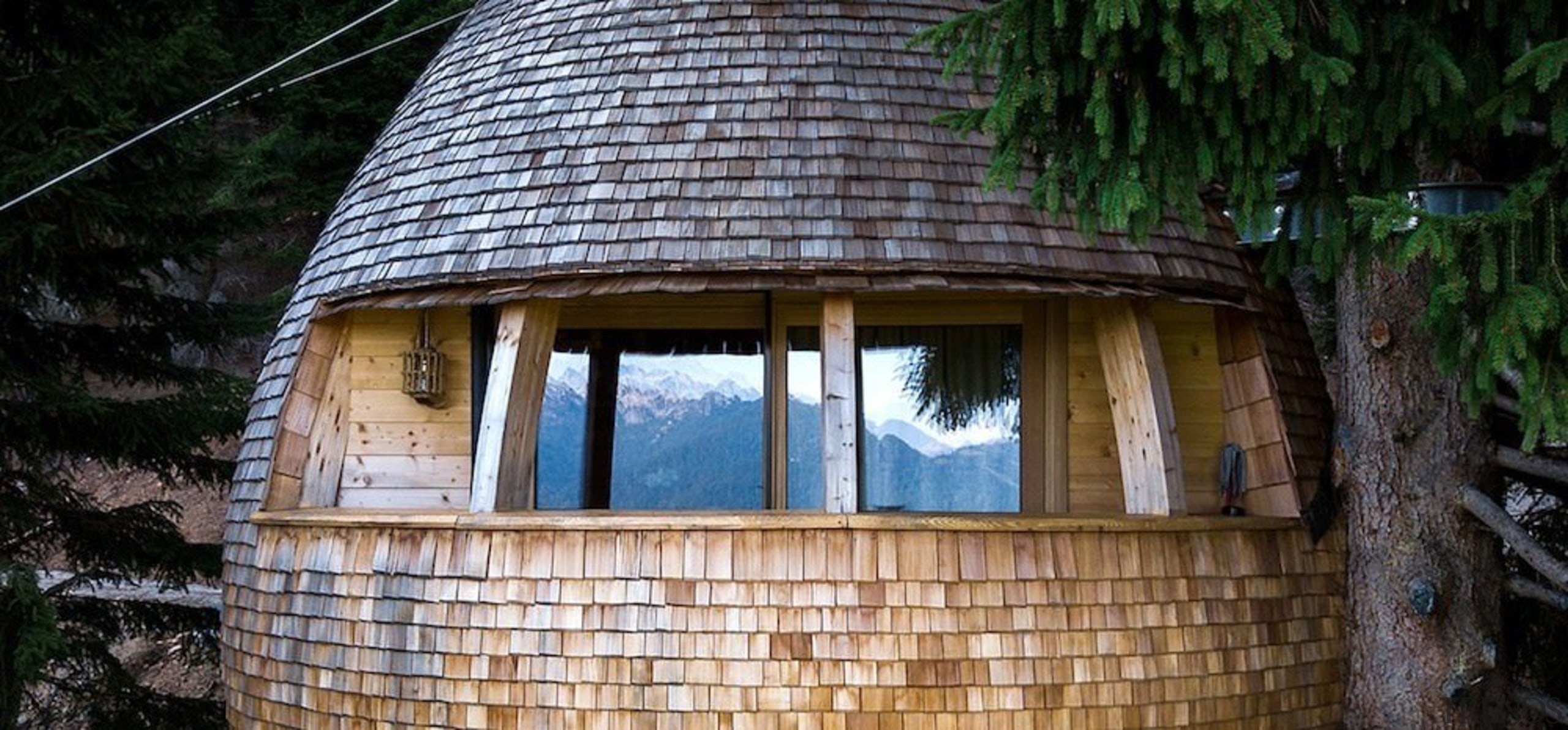 A balcony with unmatched views - A balcony cottage, facade, home, house, hut, log cabin, shack, shed, tree, window, wood, black