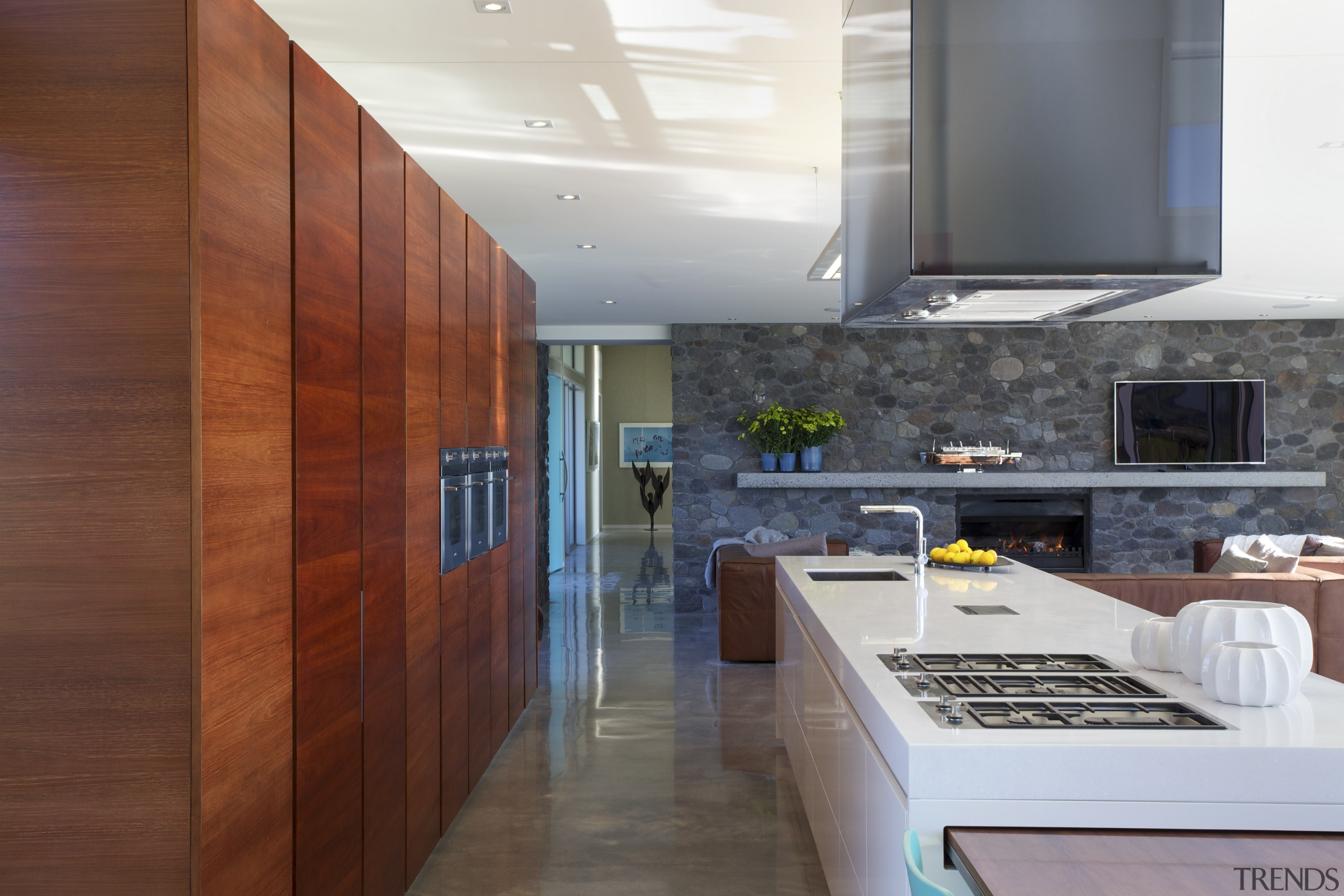 ​​​​​​​Australian blackwood cabinets feature in this kitchen in architecture, building, cabinetry, ceiling, countertop, floor, flooring, furniture, hardwood, home, house, interior design, kitchen, loft, plywood, property, real estate, room, tile, wood flooring, gray, brown
