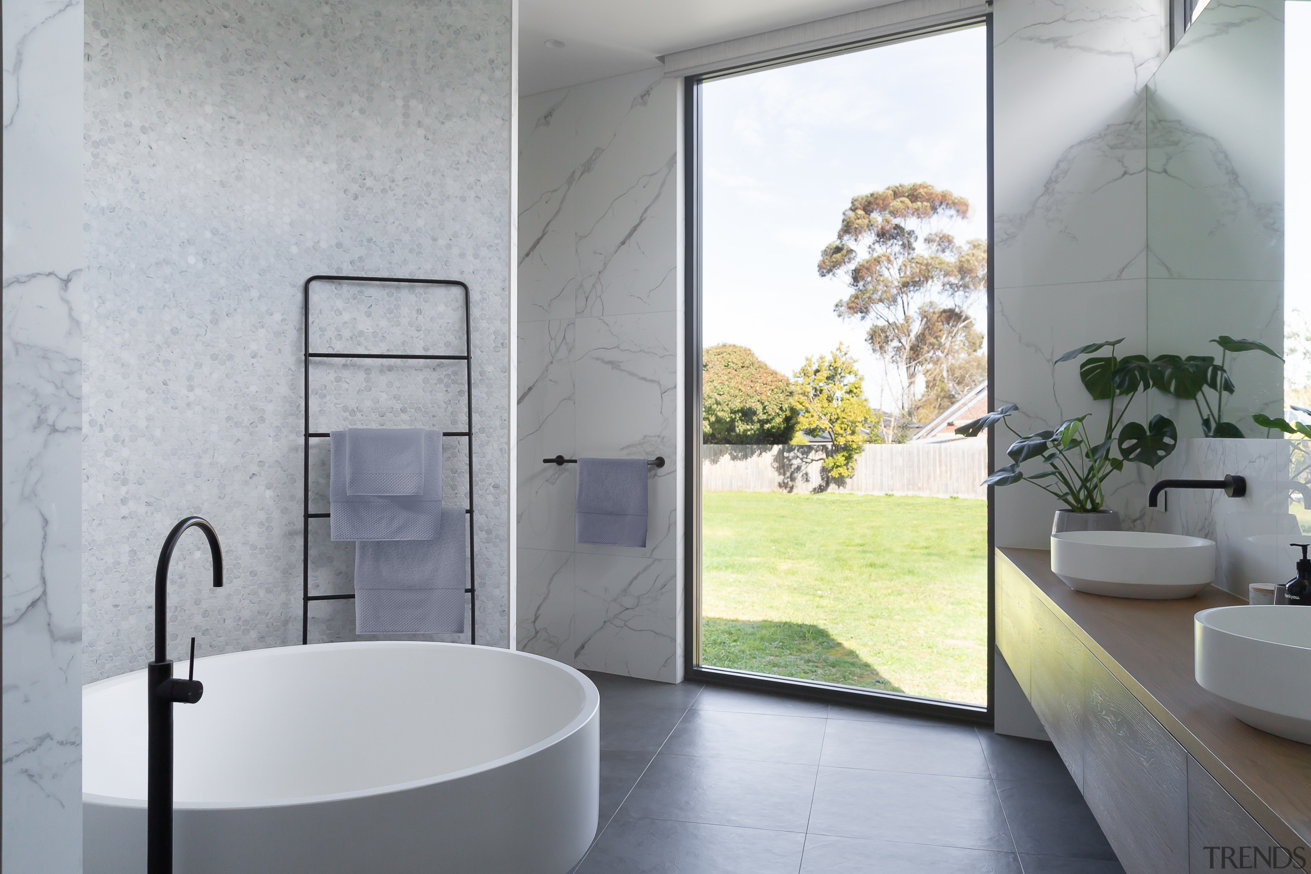 A fixed window brings light and views into gray