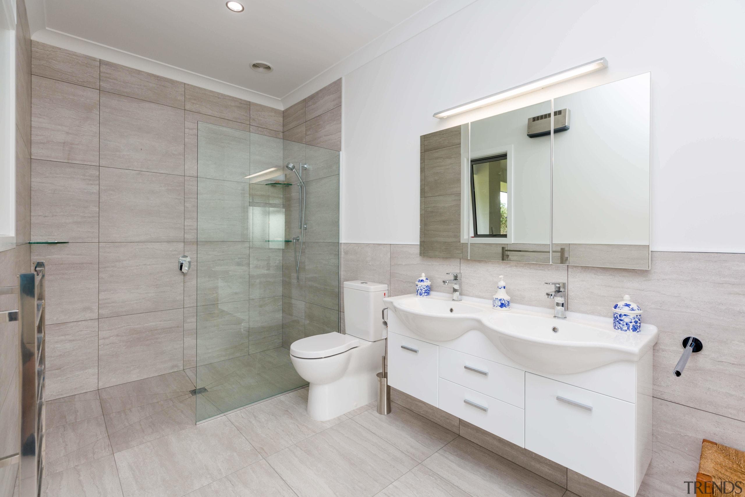 This master suite features has a Michel Caesar bathroom, estate, floor, home, interior design, property, real estate, room, sink, tile, gray