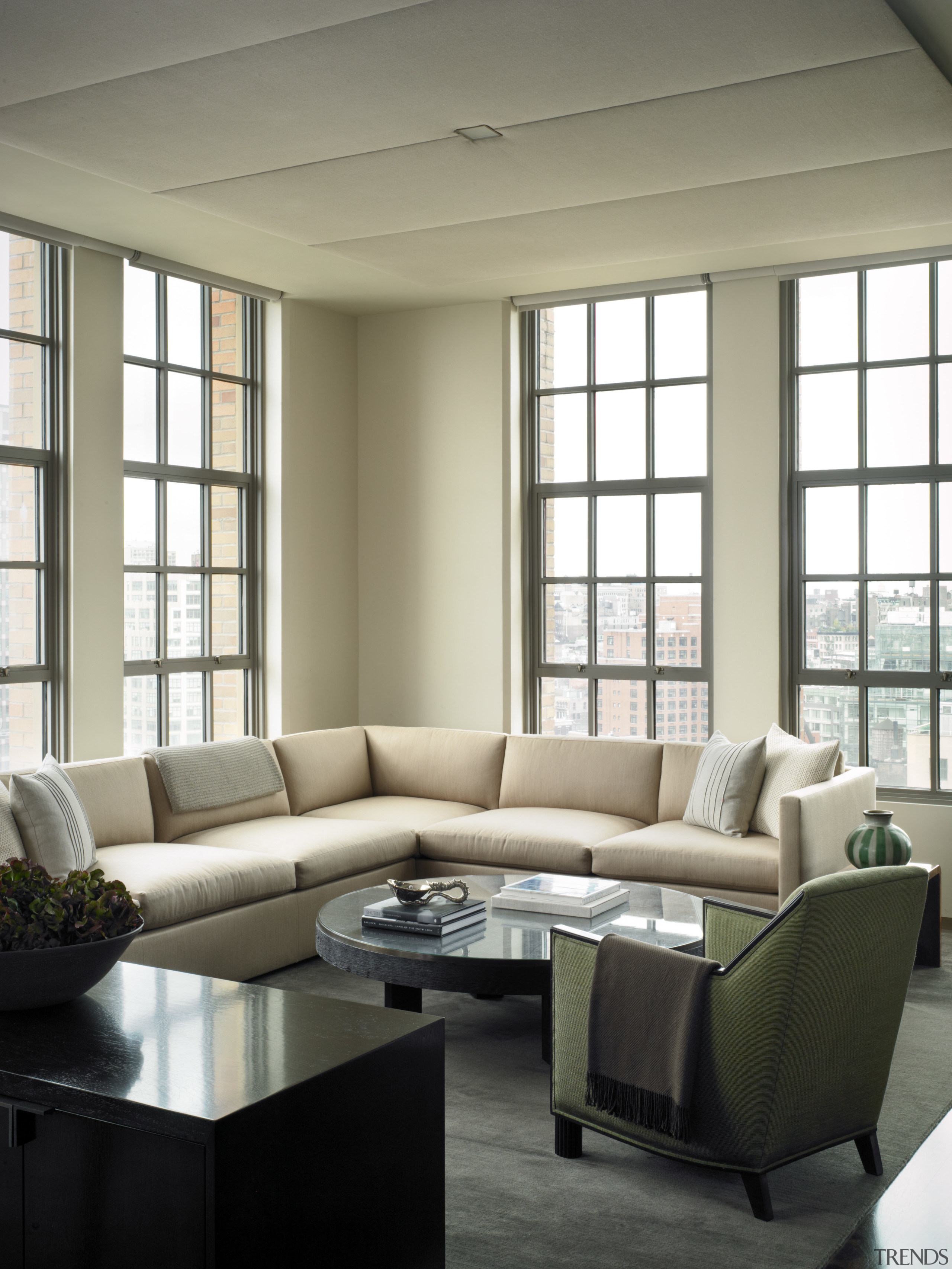 View of this contemporary apartment that has been ceiling, chair, couch, daylighting, furniture, home, interior design, living room, loveseat, room, table, window, window covering, window treatment, gray, white