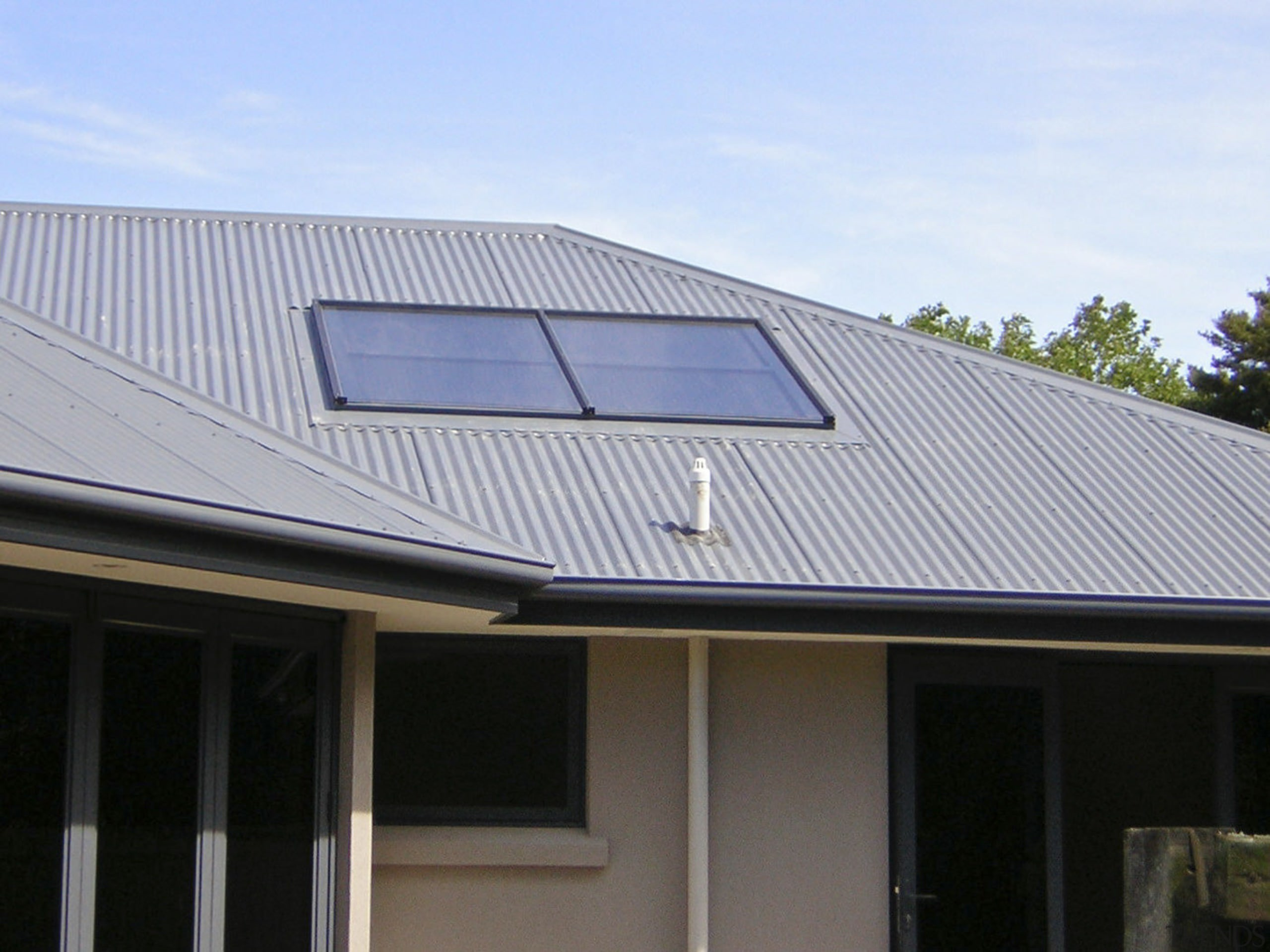 This large home efficiently uses solar energy thanks daylighting, facade, house, roof, siding, solar energy, solar panel, solar power, window, gray, black