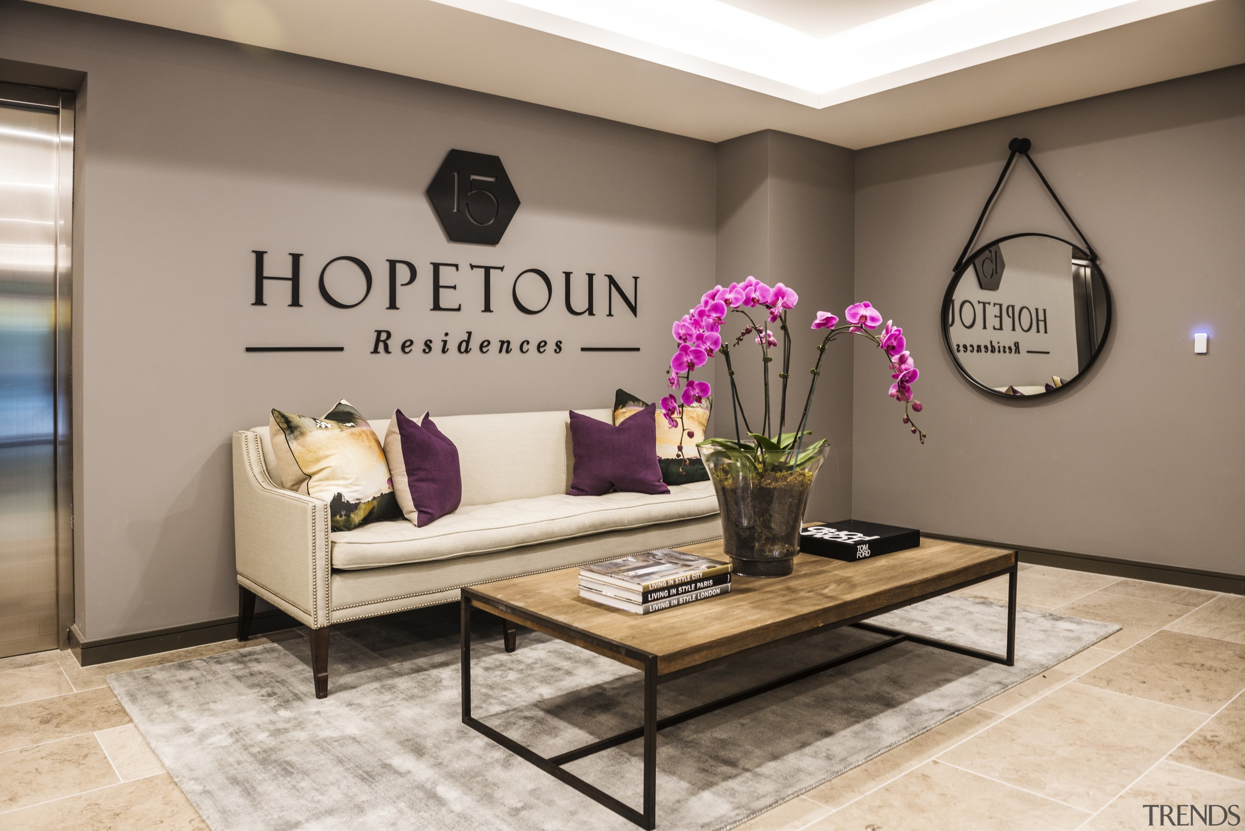 The lift lobby at Hopetoun Residences has coffered floor, flooring, furniture, home, interior design, living room, table, gray, brown