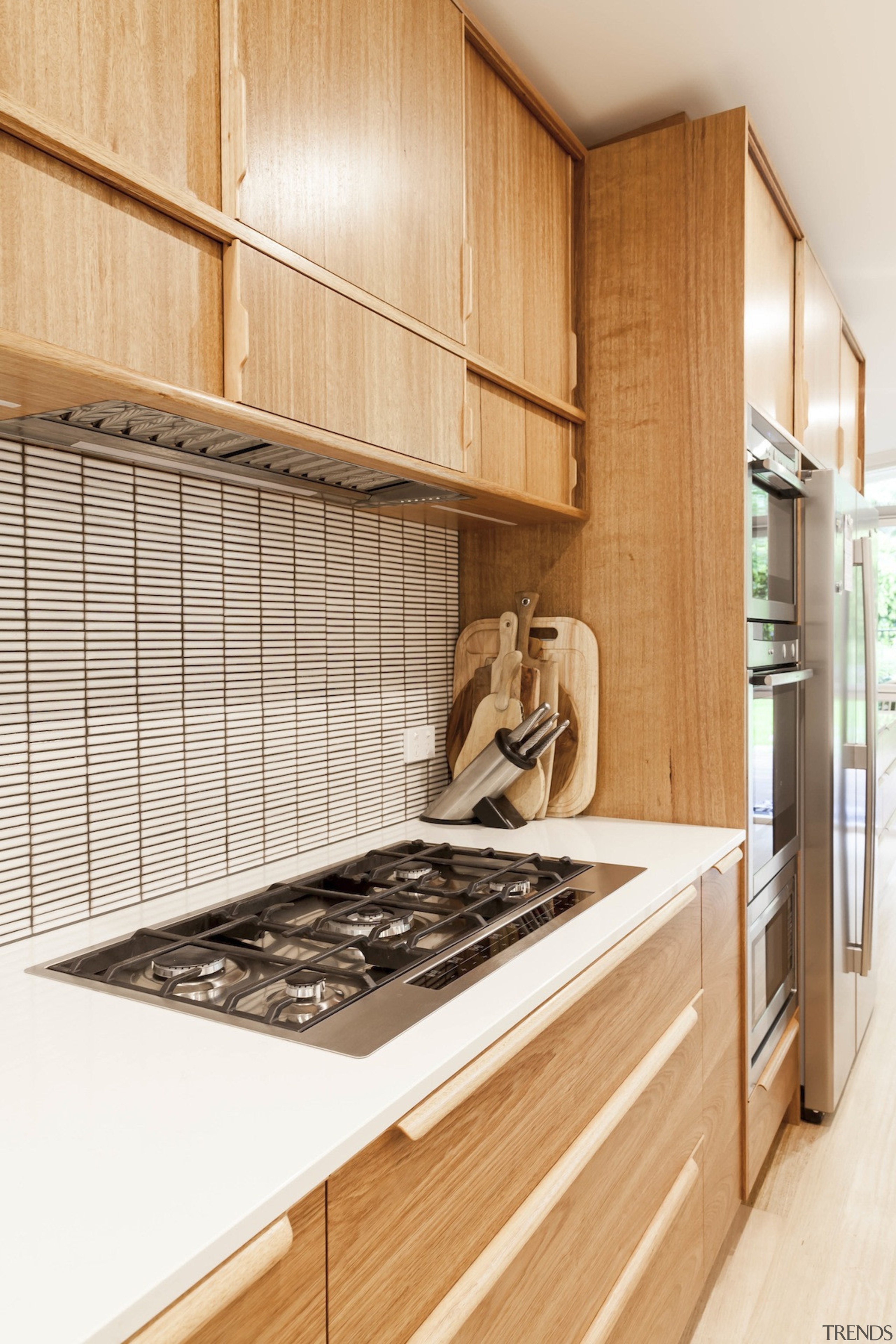 Wood cabinetry gives the kitchen a sustainable look cabinetry, countertop, cuisine classique, interior design, kitchen, room, white, orange