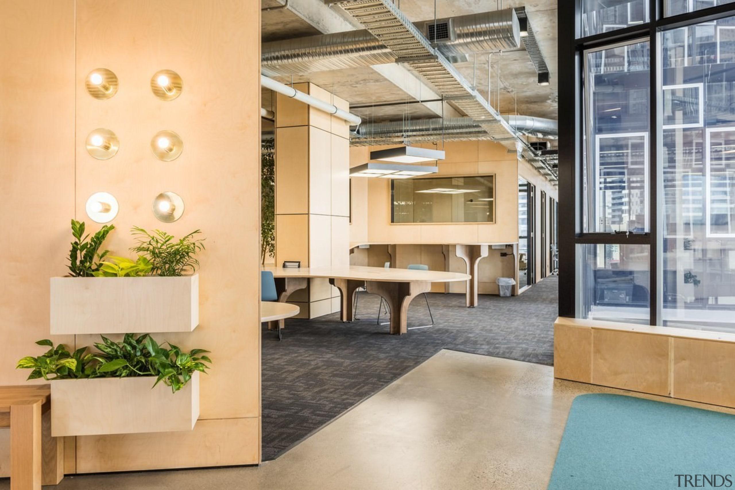 Designed by: Siren Design GroupPhotography by Cheyne floor, flooring, interior design, lobby, loft, orange, gray