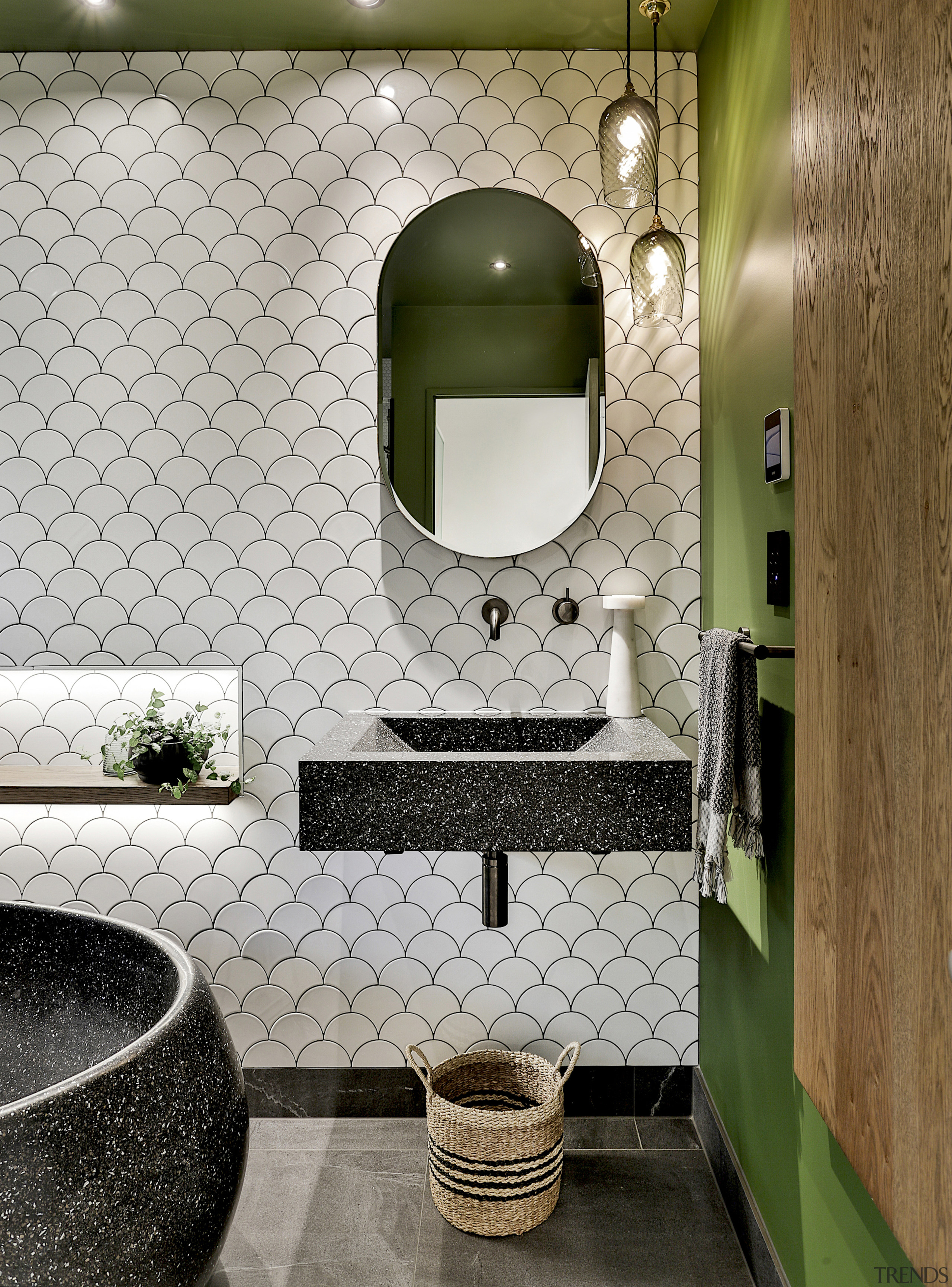 Earthy tones are continued through into the charcoal-coloured, architecture, bathroom, building, ceramic, countertop, floor, flooring, furniture, green, house, interior design, marble, material property, plumbing fixture, property, restroom, room, sink, tile, toilet, wall, gray, brown