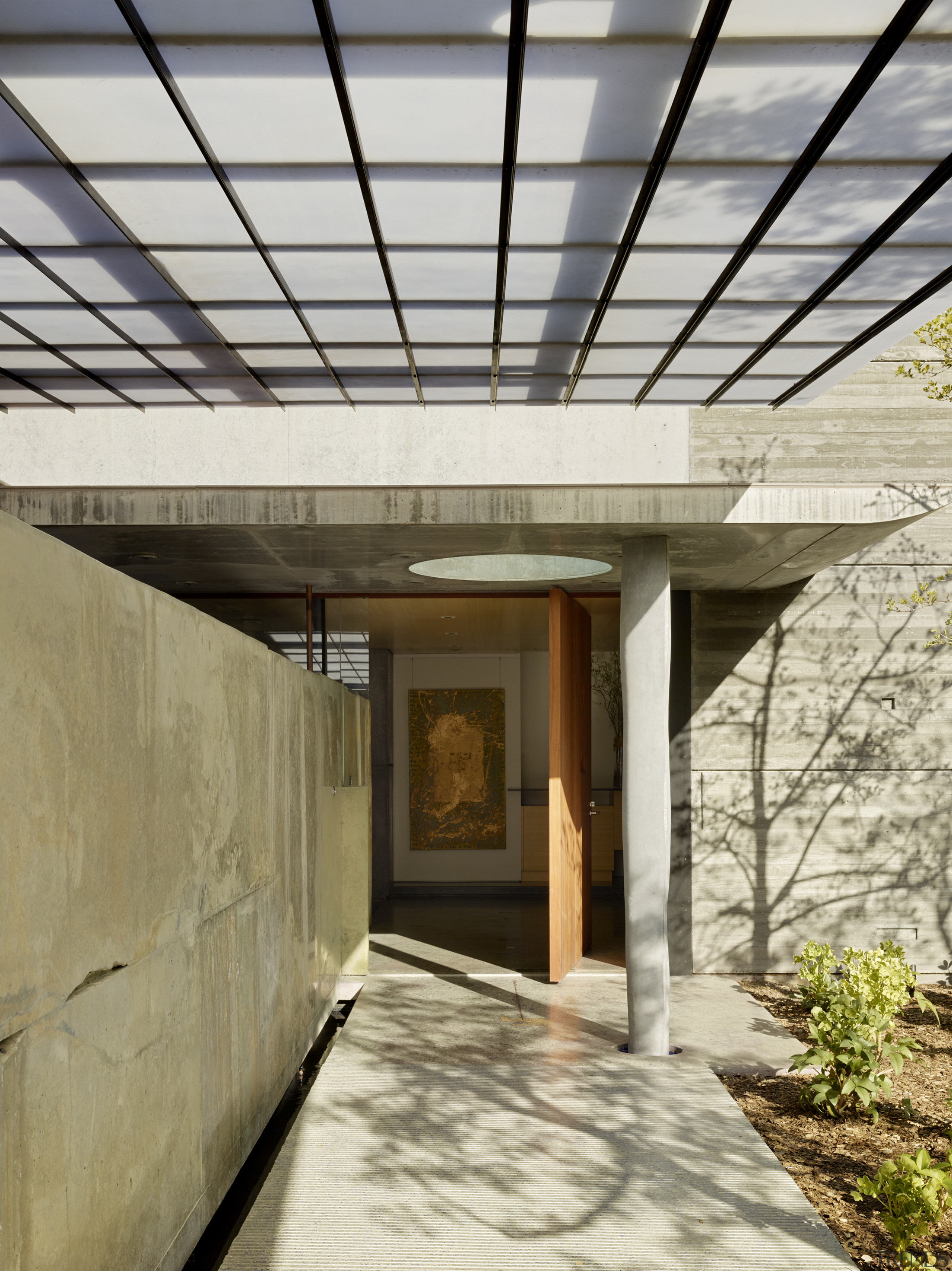 The structural column at the entrance to this architecture, home, house, roof, walkway, entranceway, FuTung Cheng,  Cheng Design