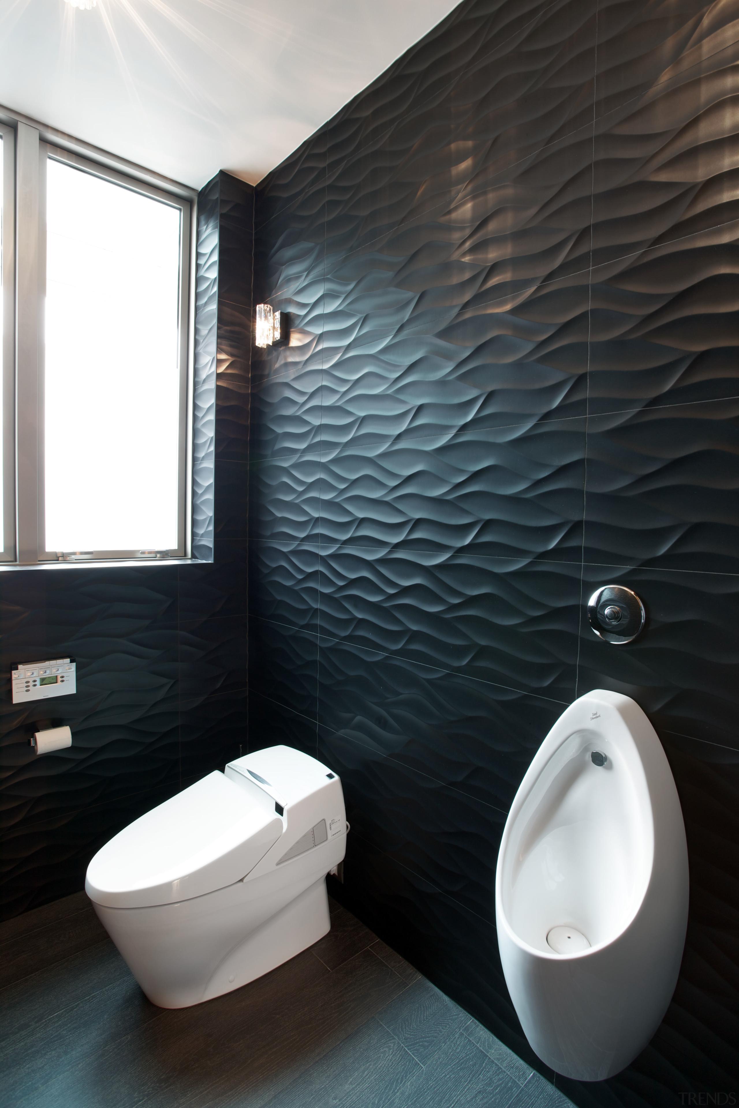 The wall tiles lining the toilet area in bathroom, bidet, ceramic, floor, interior design, plumbing fixture, product design, room, tap, toilet, toilet seat, black