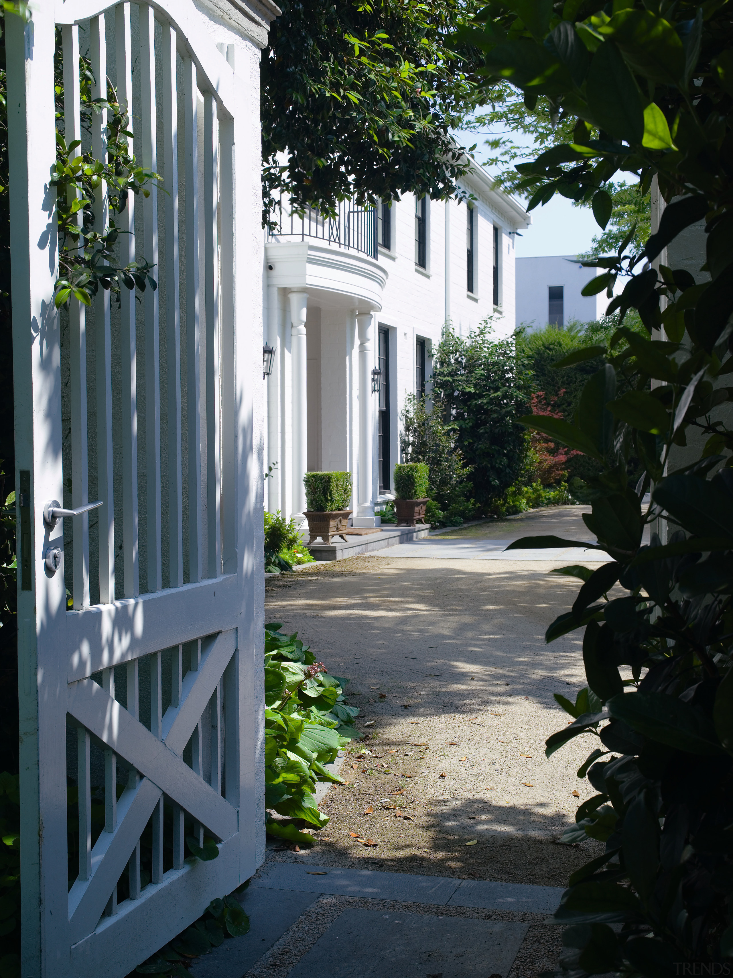 An exterior view of the house and its alley, architecture, courtyard, estate, facade, garden, gate, home, house, neighbourhood, outdoor structure, property, real estate, residential area, tree, walkway, window, black