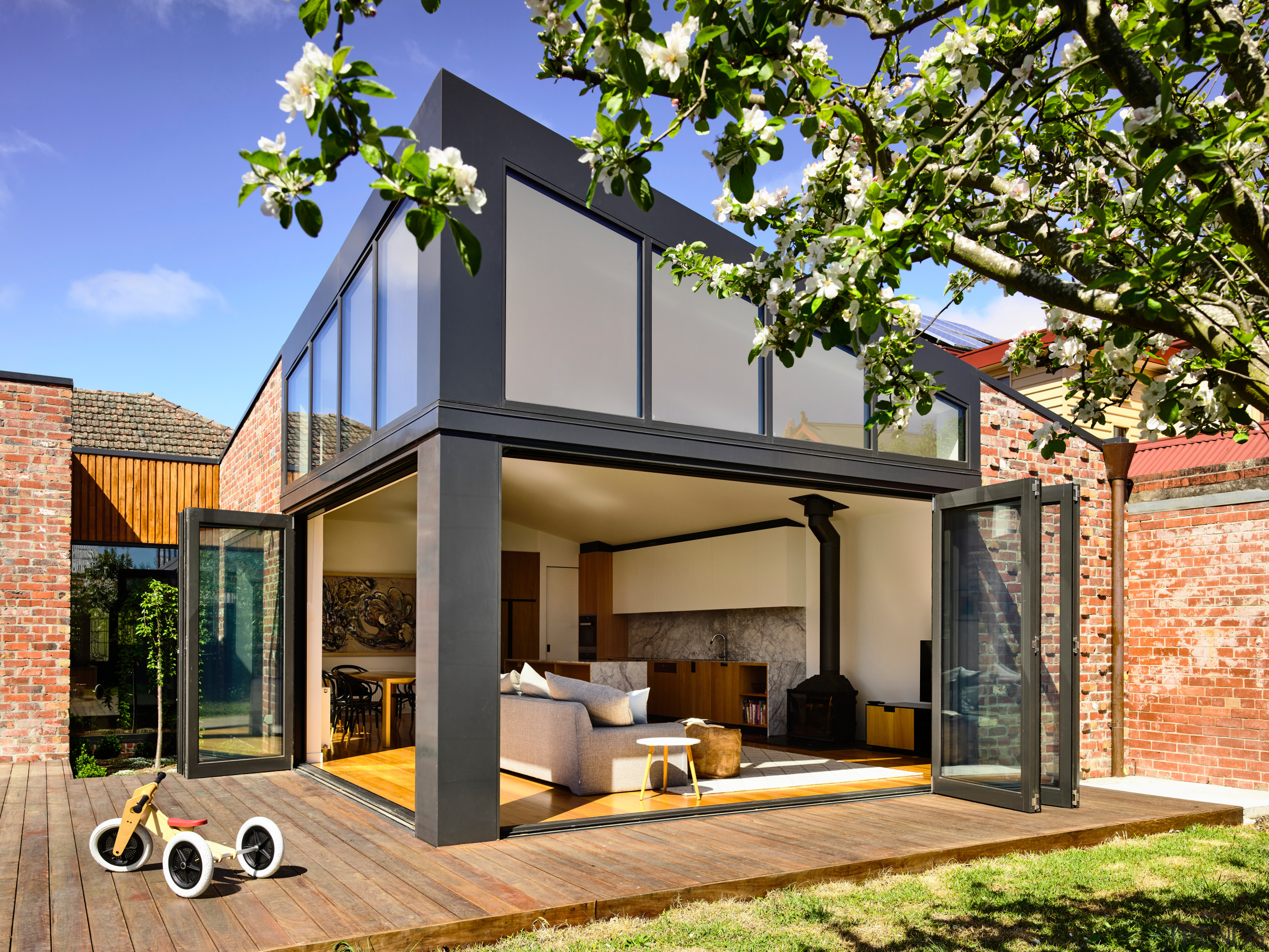 ​​​​​​​To match the existing home's cladding, recycled clinker architecture, backyard, home, house, property, residential area, brick extension, renovation, deck, extension, bifold windows,  porter architects