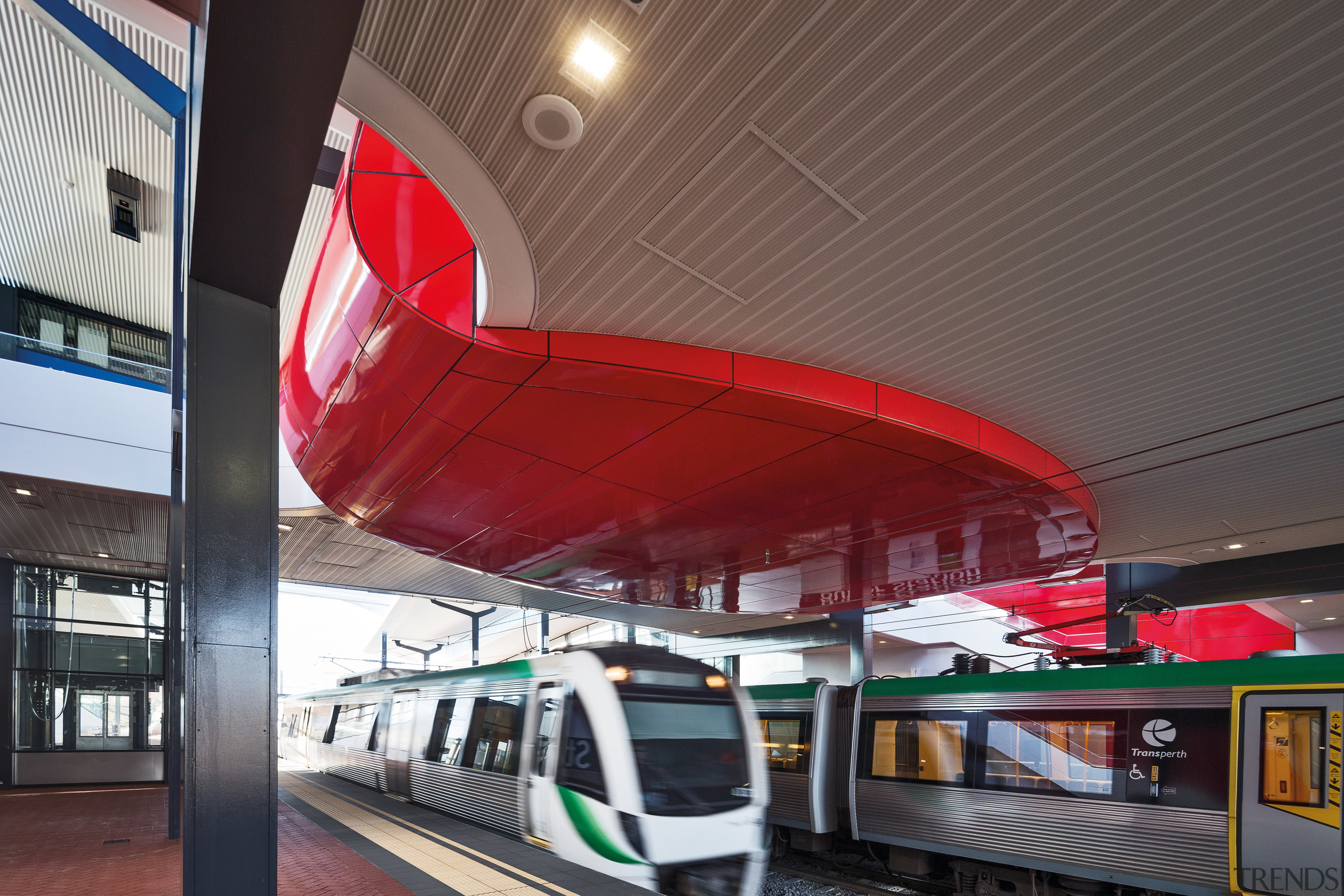 This curved red canopy in the new Butler architecture, metropolitan area, public transport, red, train, train station, transport, black