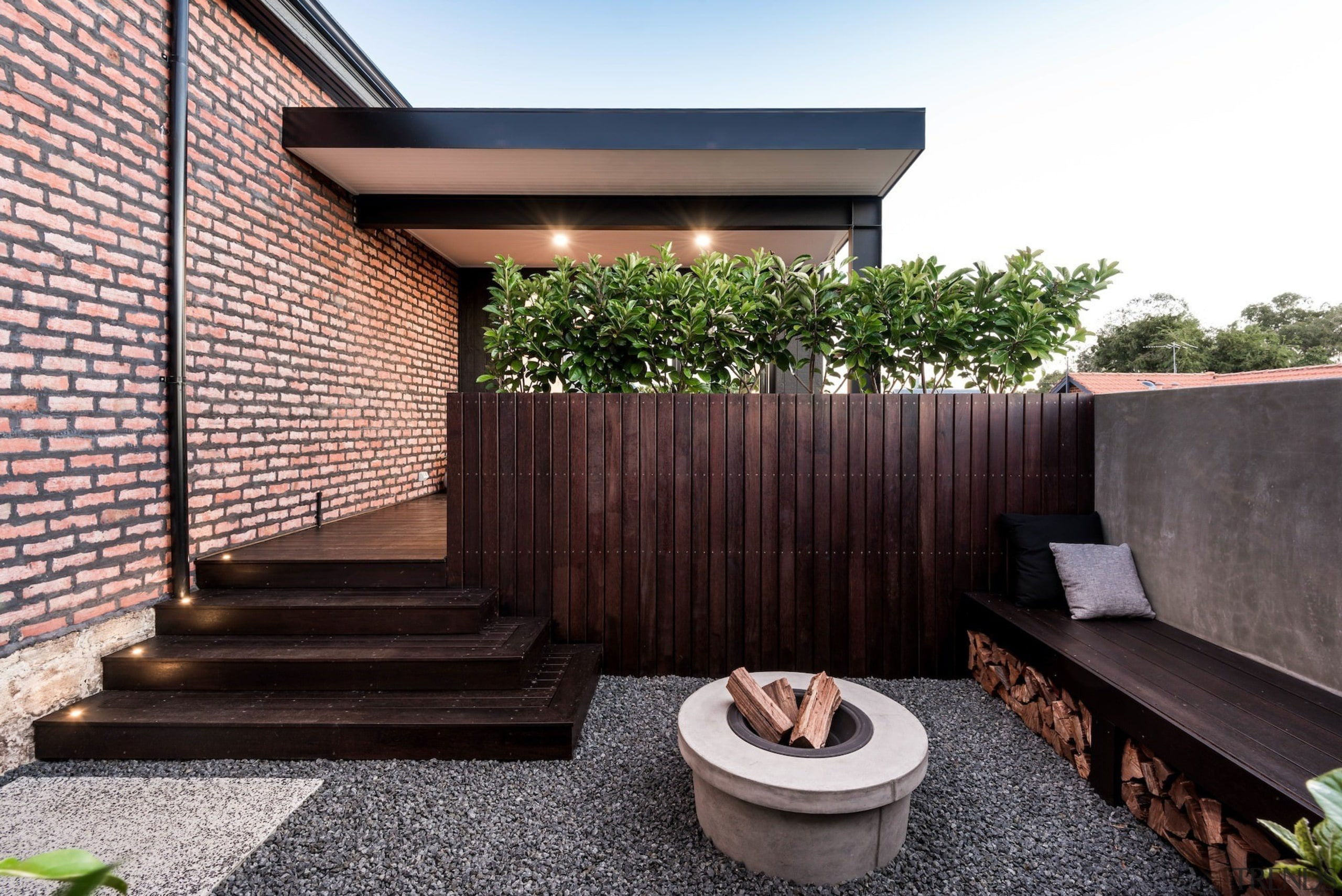 This private outdoor area features a fire pit architecture, courtyard, facade, home, house, outdoor structure, property, real estate, residential area, roof, black, white