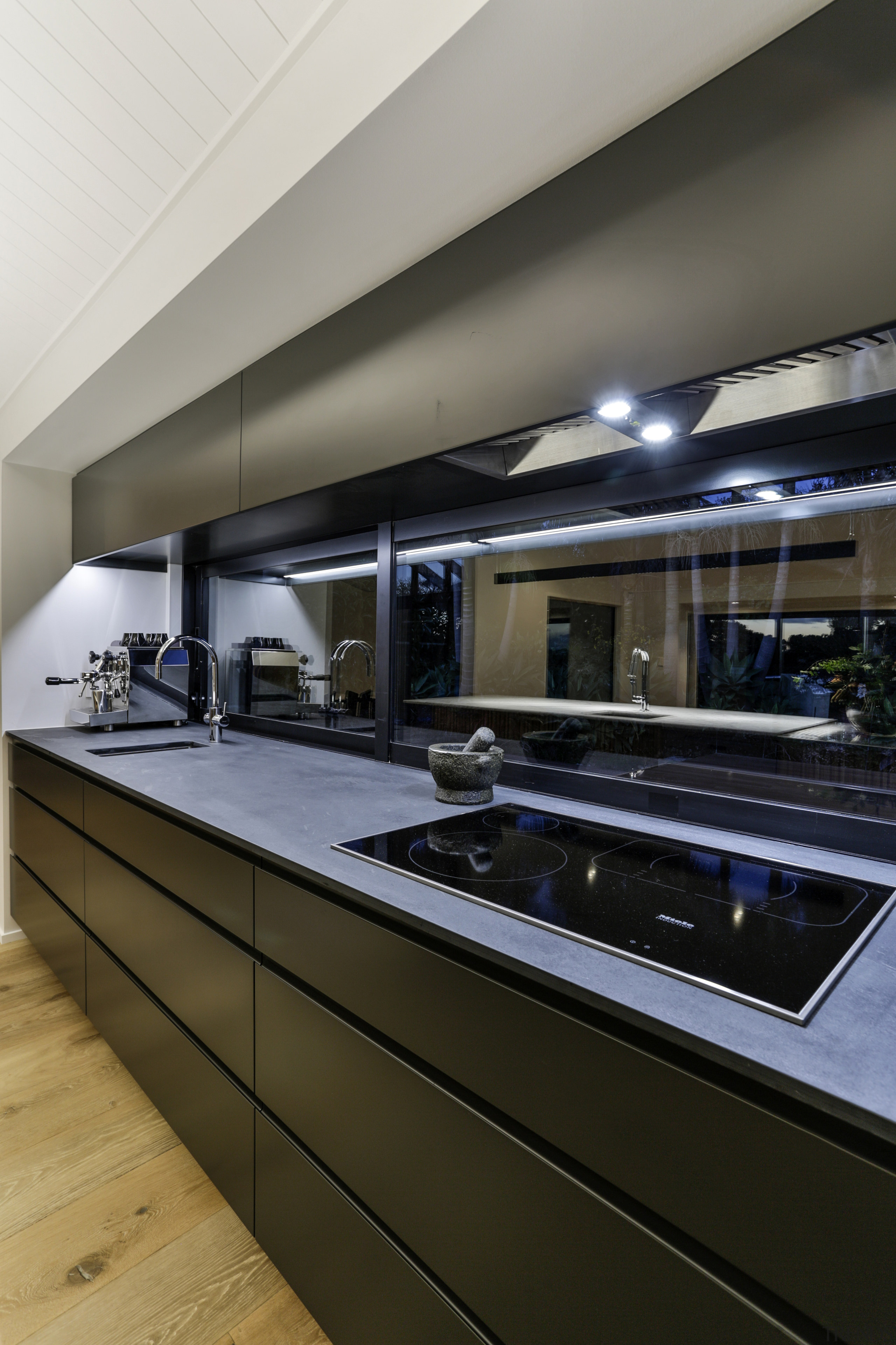Engineered wood floors complement the marble, stainless steel gray, black, brown
